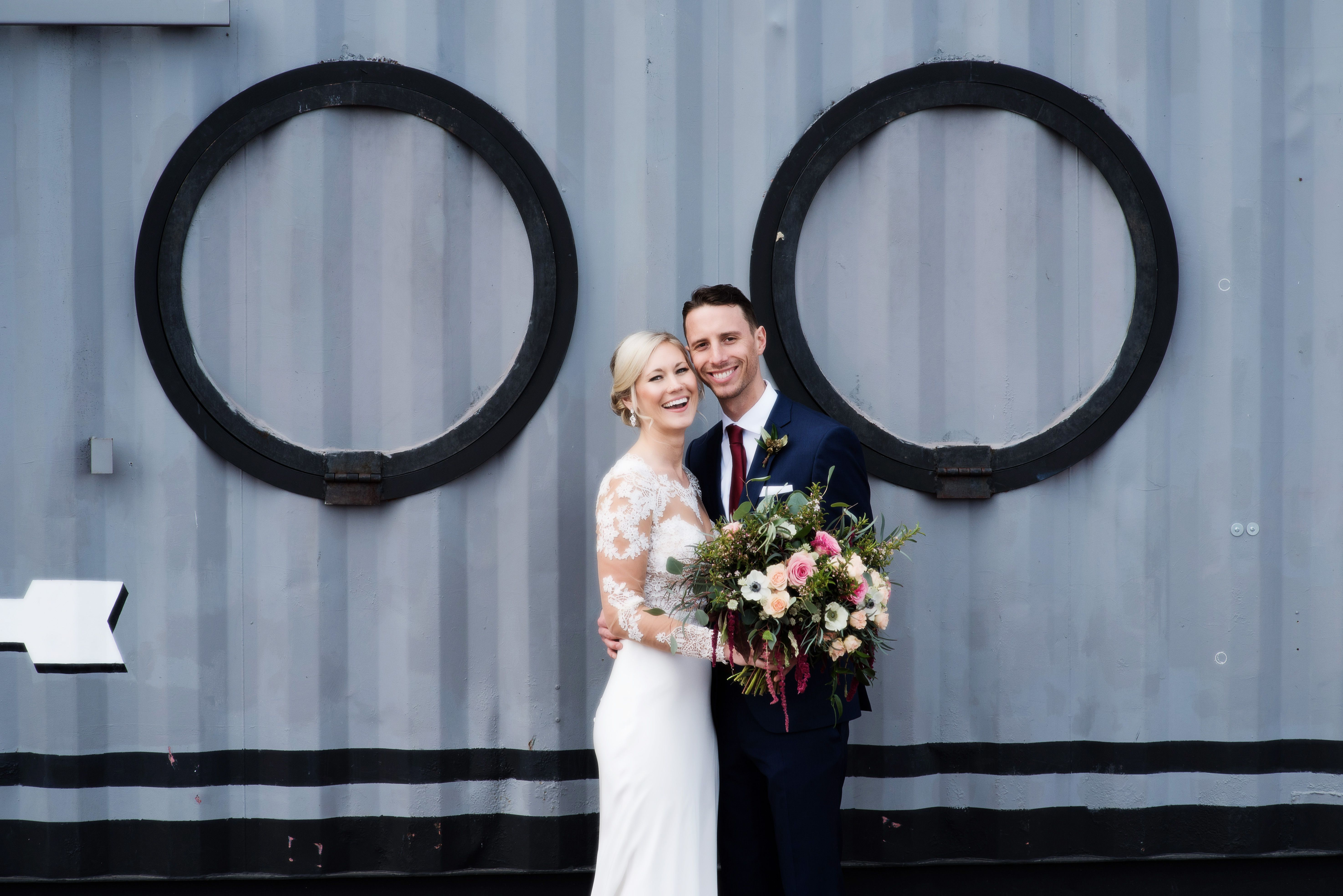 Jenna McGivney and Daniel Garrison share a smile just after seeing each other for the first time on their wedding day.