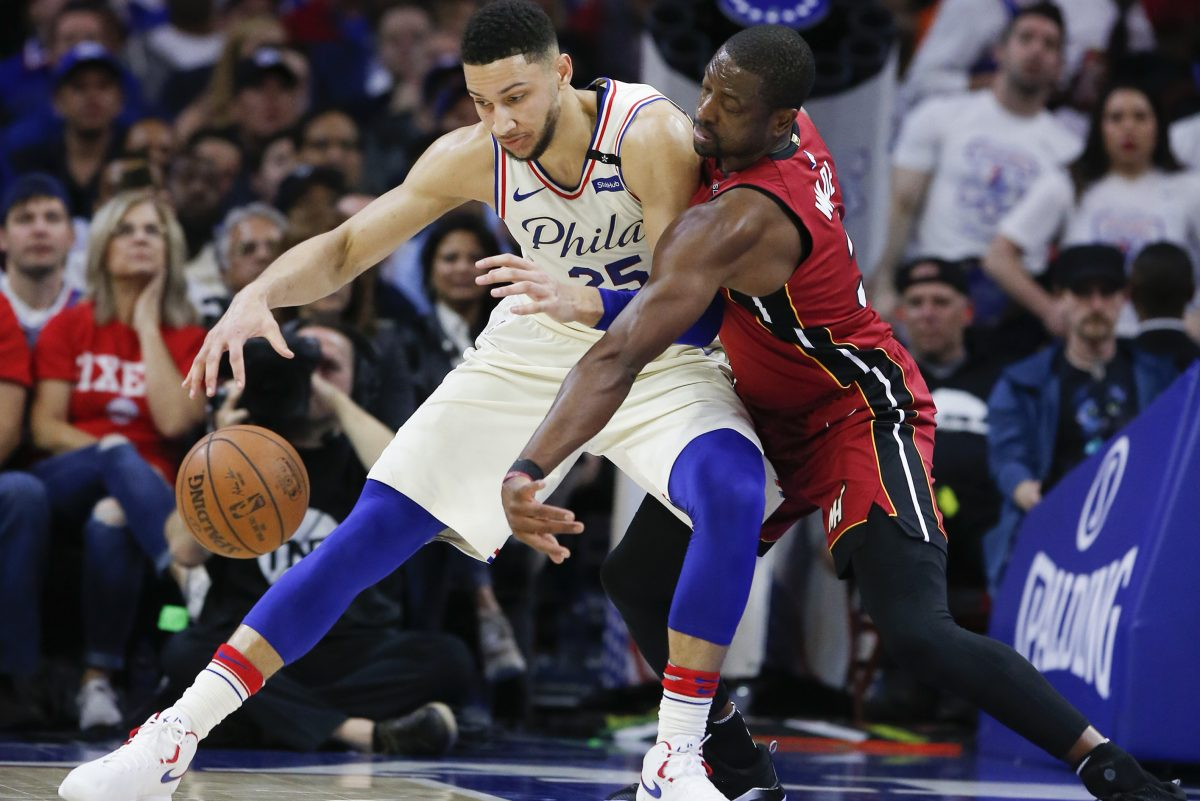 Sixers guard Ben Simmons backs down Heat guard Dwyane Wade during Game 5 of the Sixers-Heat playoff series on Tuesday.