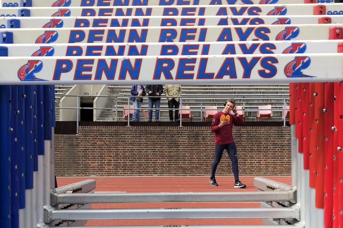Penn's Alex Sislo walks across the track before the start of the Penn Relays men's decathlon at Franklin Field in Philadelphia, PA on April 24, 2018.