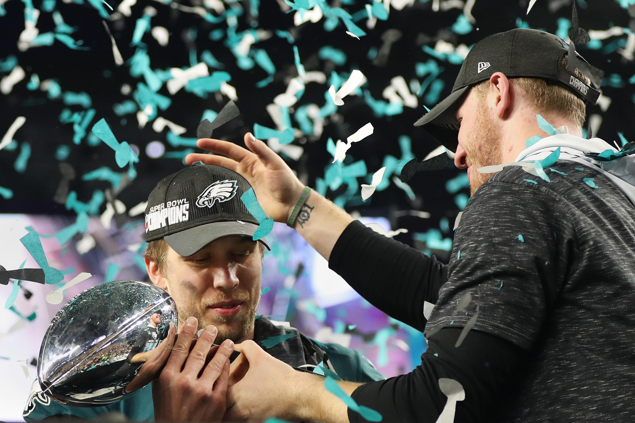 Eagles quarterback Nick Foles and injured quarterback Carson Wentz celebrate after Super Bowl LII, at U.S. Bank Stadium in Minneapolis, Minnesota, Sunday, Feb. 4, 2018. The Eagles won 41-33.