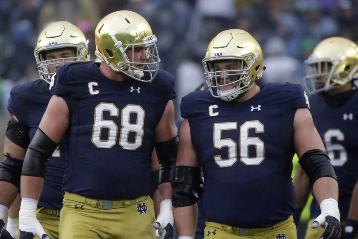 Notre Dame offensive lineman Mike McGlinchey (left, with fellow first-round prospect Quenton Nelson) is a Penn Charter grad and a cousin of Falcons quarterback Matt Ryan.