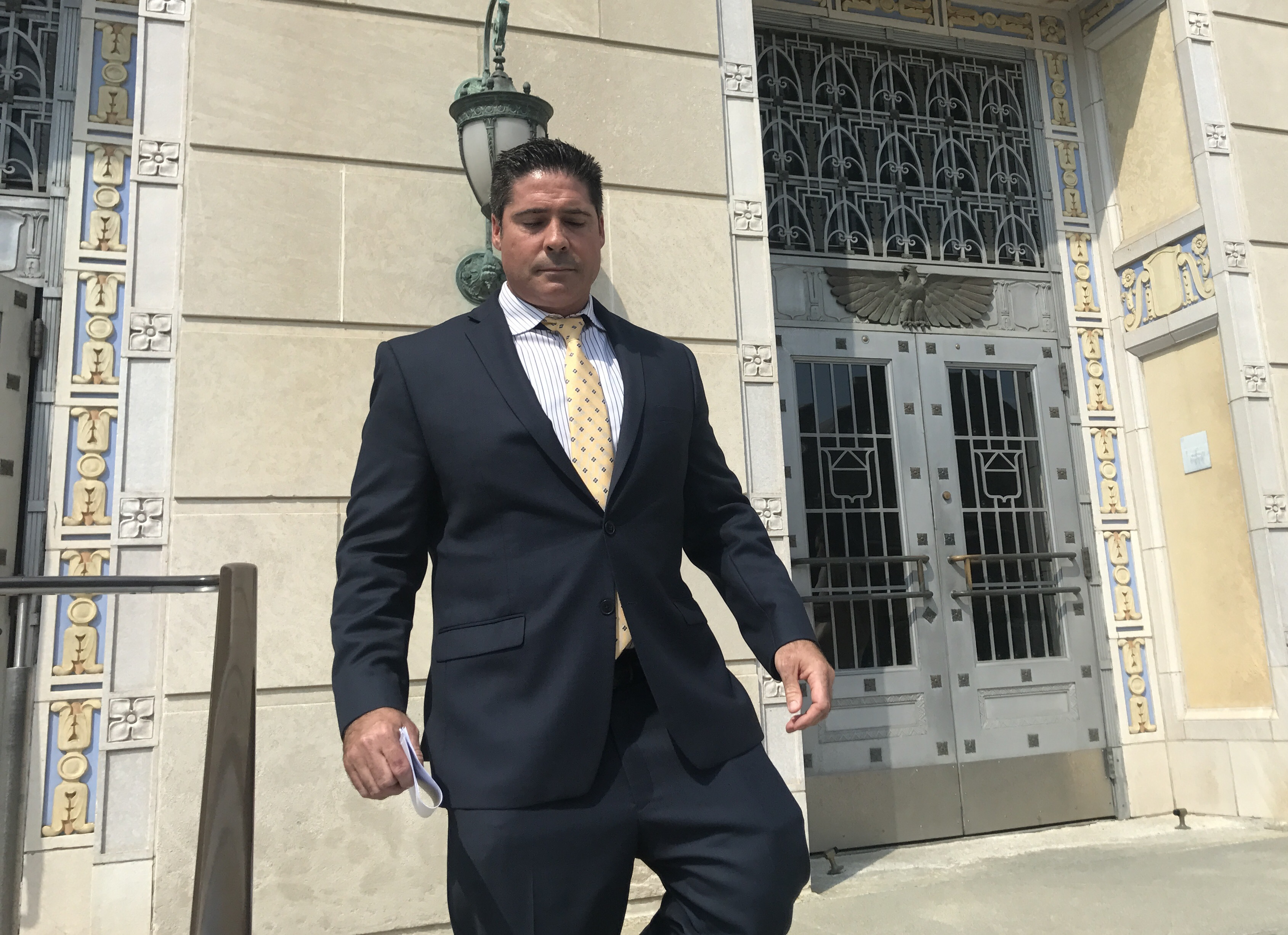 Matthew Tedesco, 42, of Linwood leaves the federal courthouse in Camden after pleading guilty in a $28 million prescription drug kickback scheme involving Shore firefighters, police officers, teachers and a state trooper.