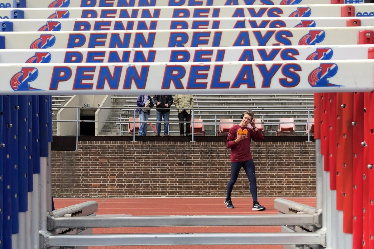 Penn's Alex Sislo walks across the track at Franklin Field before the college decathlon on Wednesday.