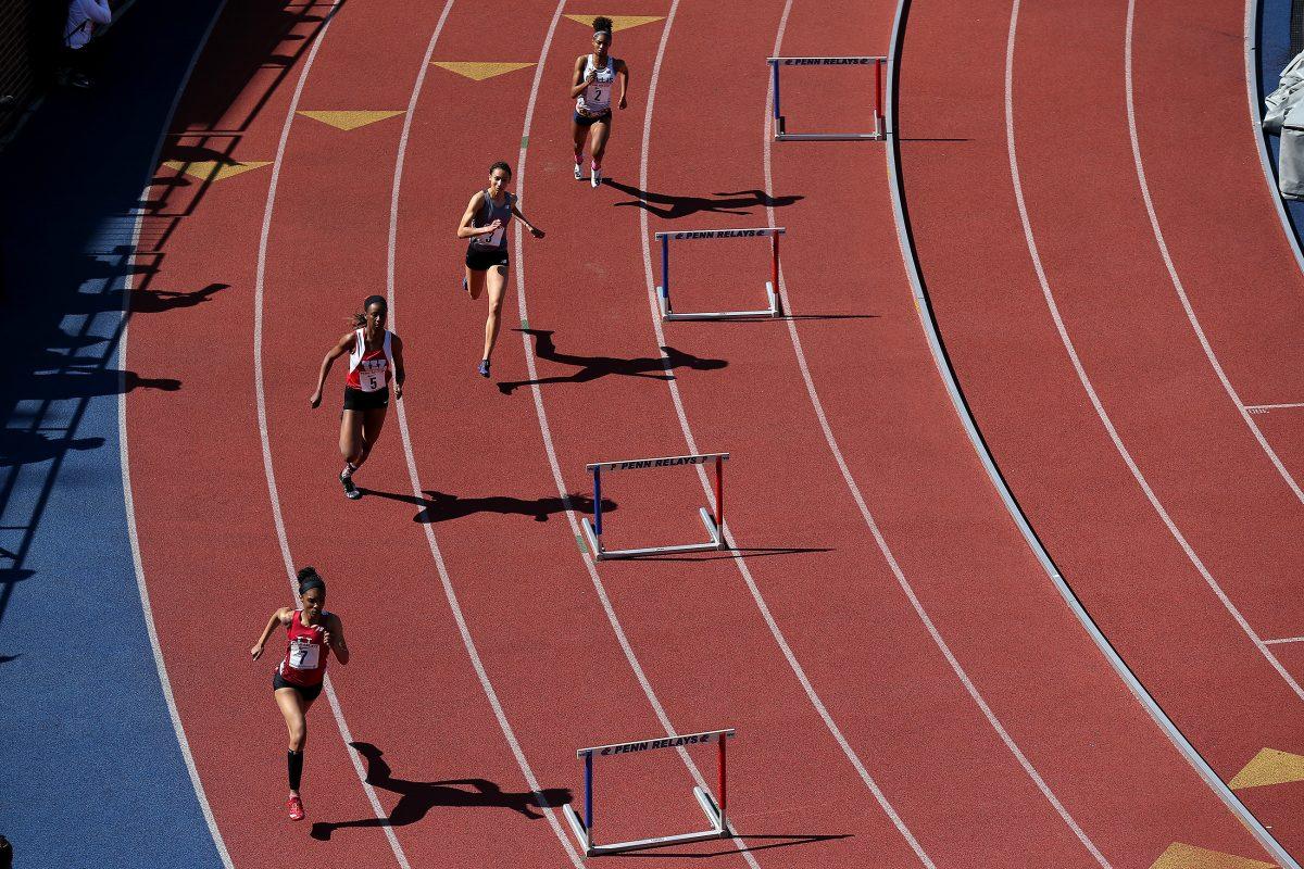 Upper Dublin´s Madison Langley Walker, left, competes in the High School Girls 400-meter hurdles championship on Thursday.