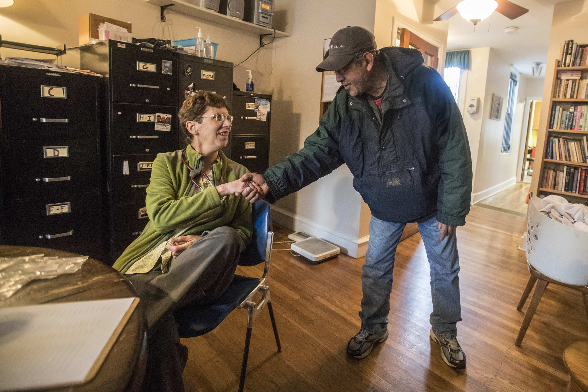 Mary Beth Appel, a nurse at the Catholic Worker Clinic in Kensington, reaches out to recieve the thanks of one of the clinicÕs clients after he was treated on Wednesday April 25, 2018.