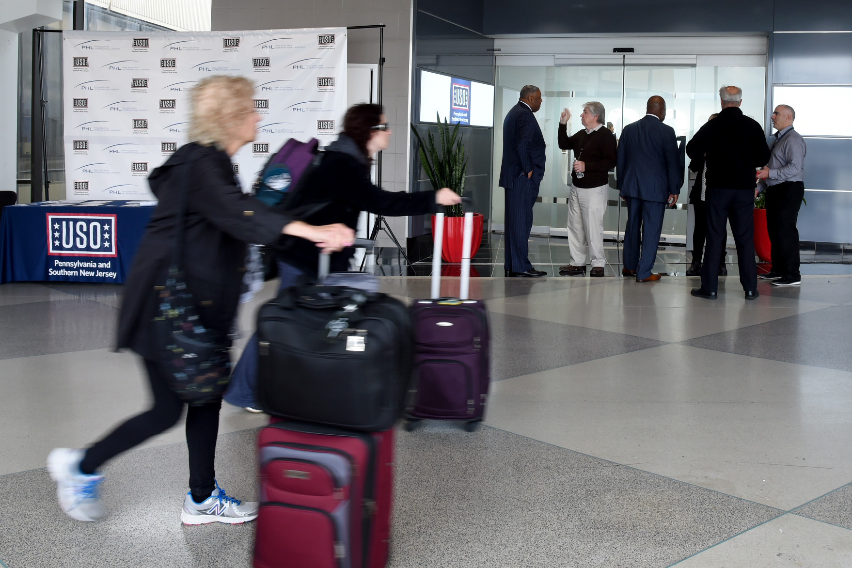Air travelers pass the new USO facility at PHL´s Terminal E.