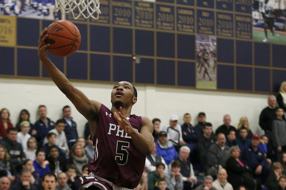 St. Joseph's Prep Darius Kinnel lays-up the basketball after stealing it from La Salle High's Jarrod Stukes (right) during the first-quarter on Friday, February 3, 2017.