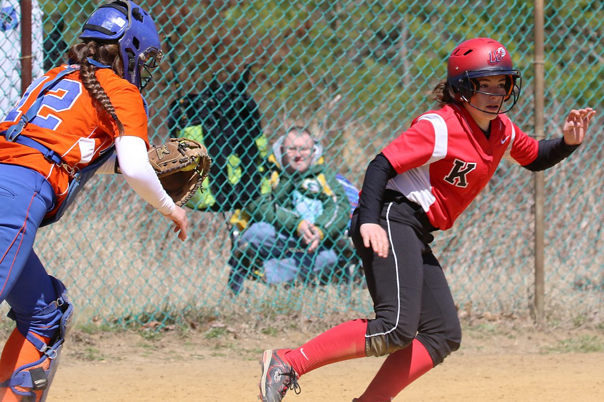 Kingsway's Sydney Maroney tries to evade Woodstown's catcher Madalyn Padio last season.
