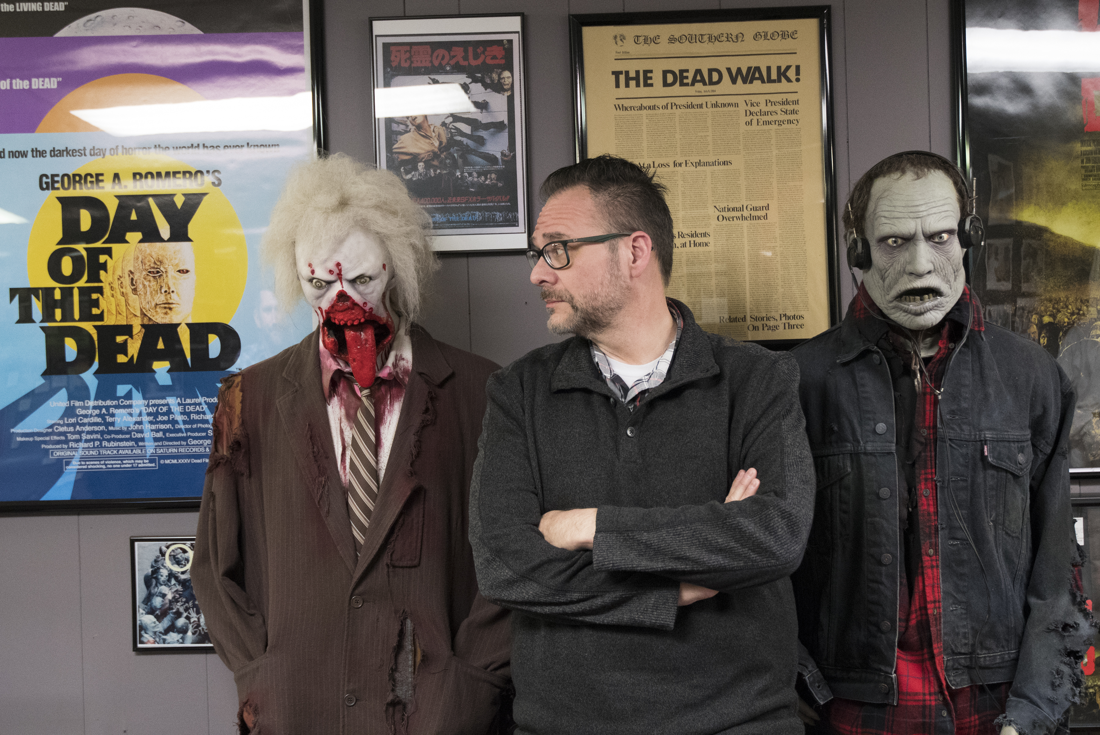 """Kevin Kriess poses with zombies inside his Living Dead Museum in Evans City, Pa., Saturday April 21, 2018. Pittsburgh native George Romero filmed """"Night of the Living Dead"""" in the Butler County town and Evans City has become a tourist attraction as a result of it´s connection to the Romero film 50 years ago this year. Photo by John Beale"""