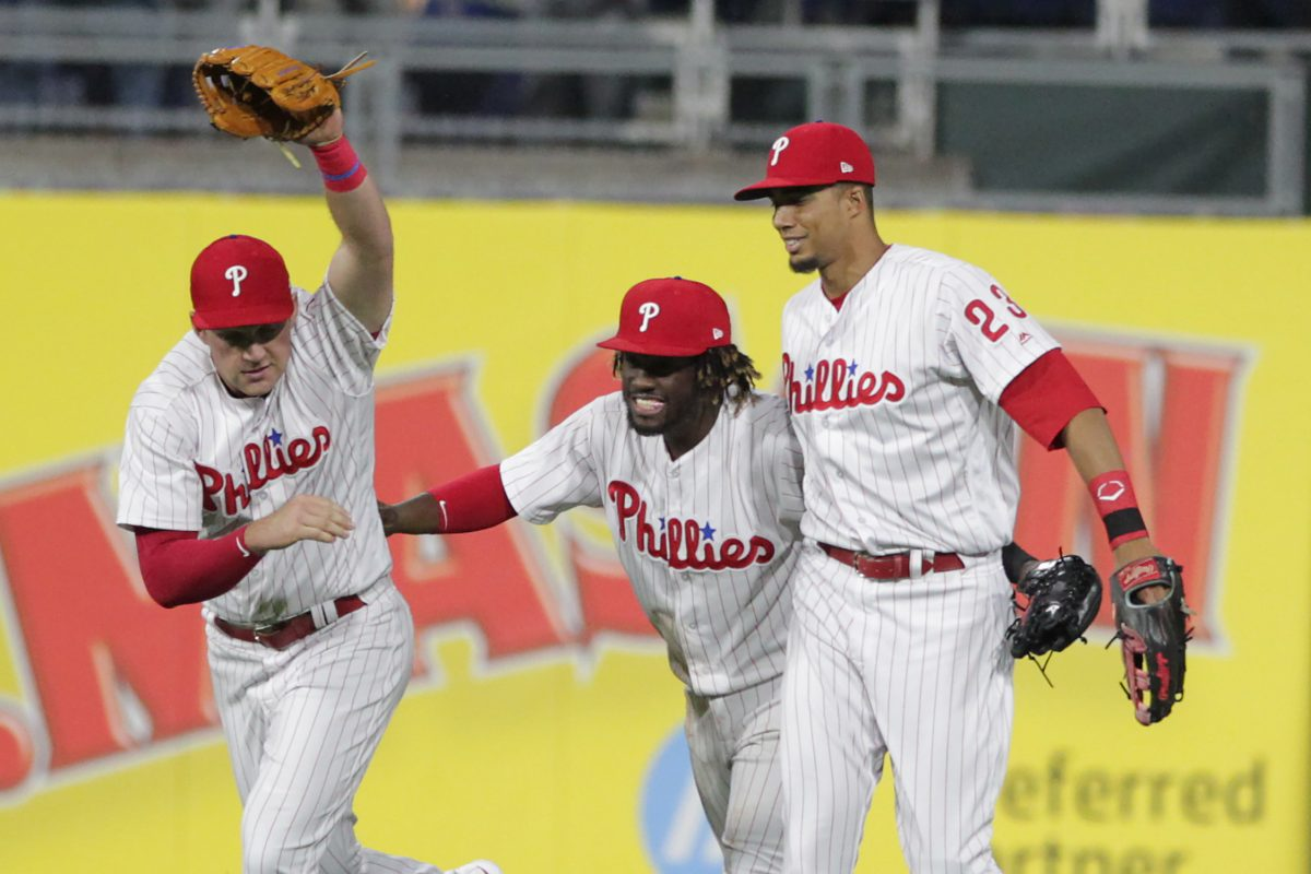 Rhys Hoskins (left), Odubel Herrera and Aaron Altherr celebrate the Phillies' win over the Diamondbacks Wednesday.