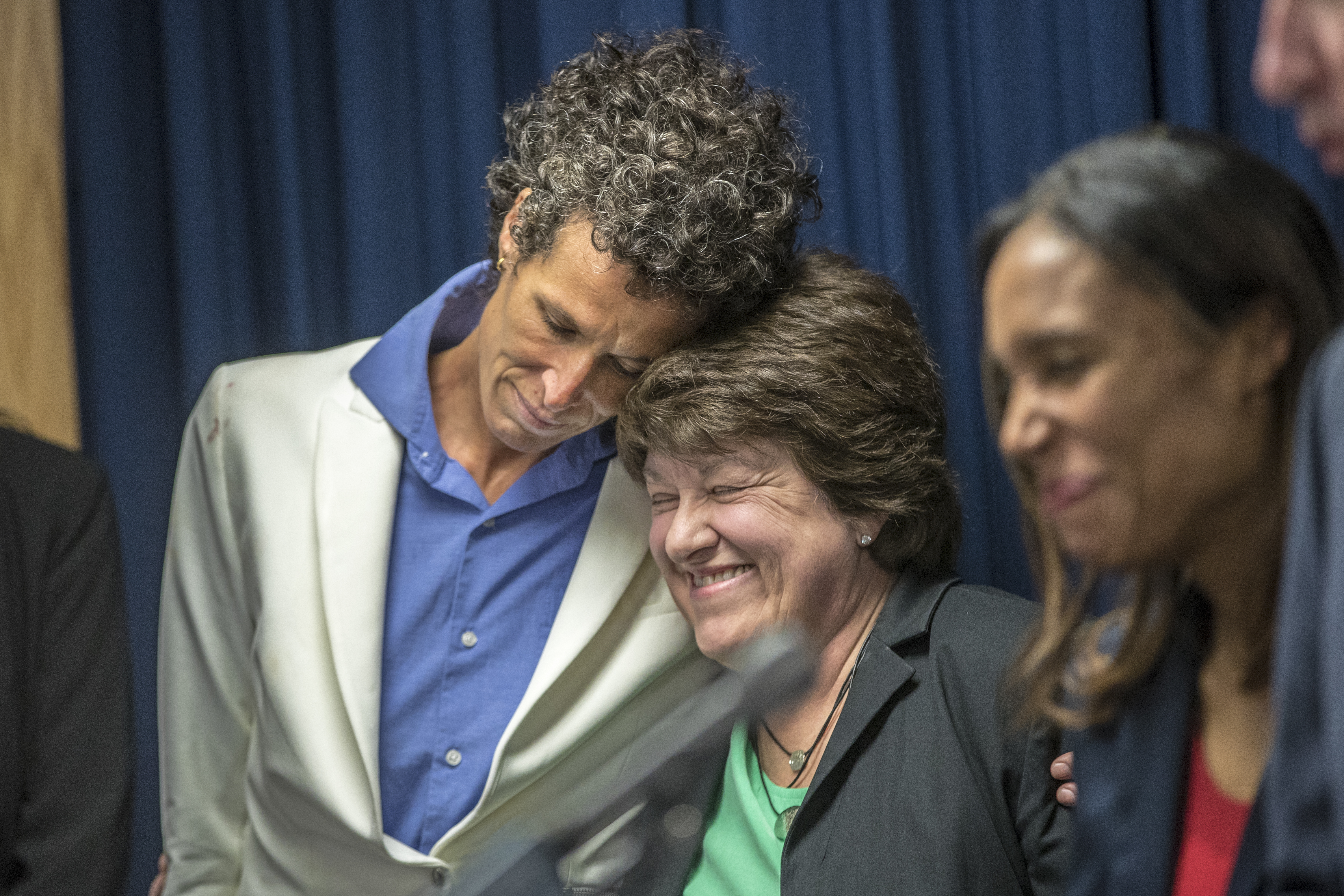 Andrea Constand, left, leans into her attorney Delores Troiani, right, during Montgomery County District Attorney Kevin Steele's press conference after the guilty verdict against Bll Cosby on three counts of sexual assualt on Thursday April 26, 2018.