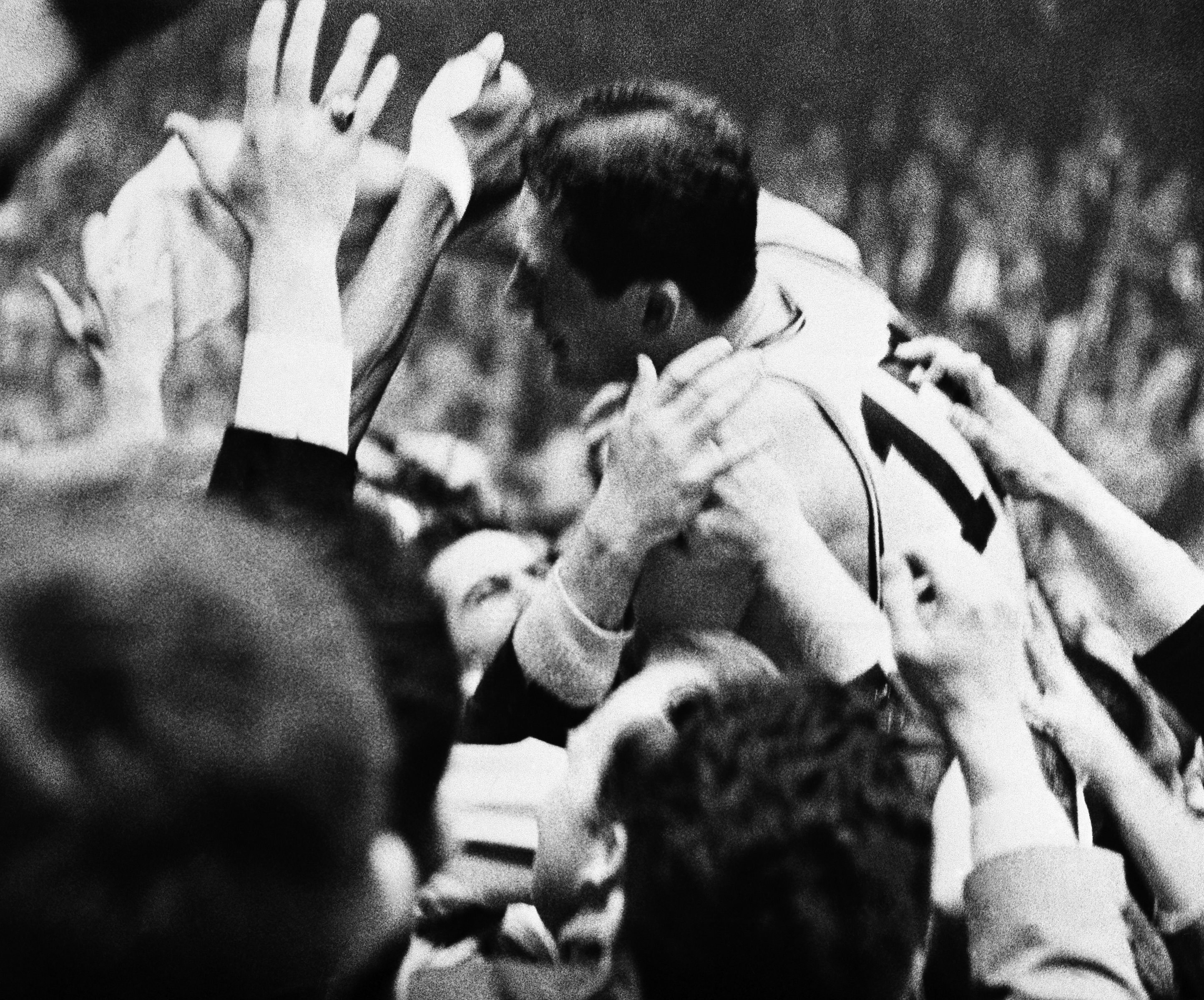 John Havlicek is mobbed by fans after intercepting the 76ers´ inbounds pass in the final seconds of the game to seal the Celtics´ Game 7 win. Boston went on to win the NBA championship.