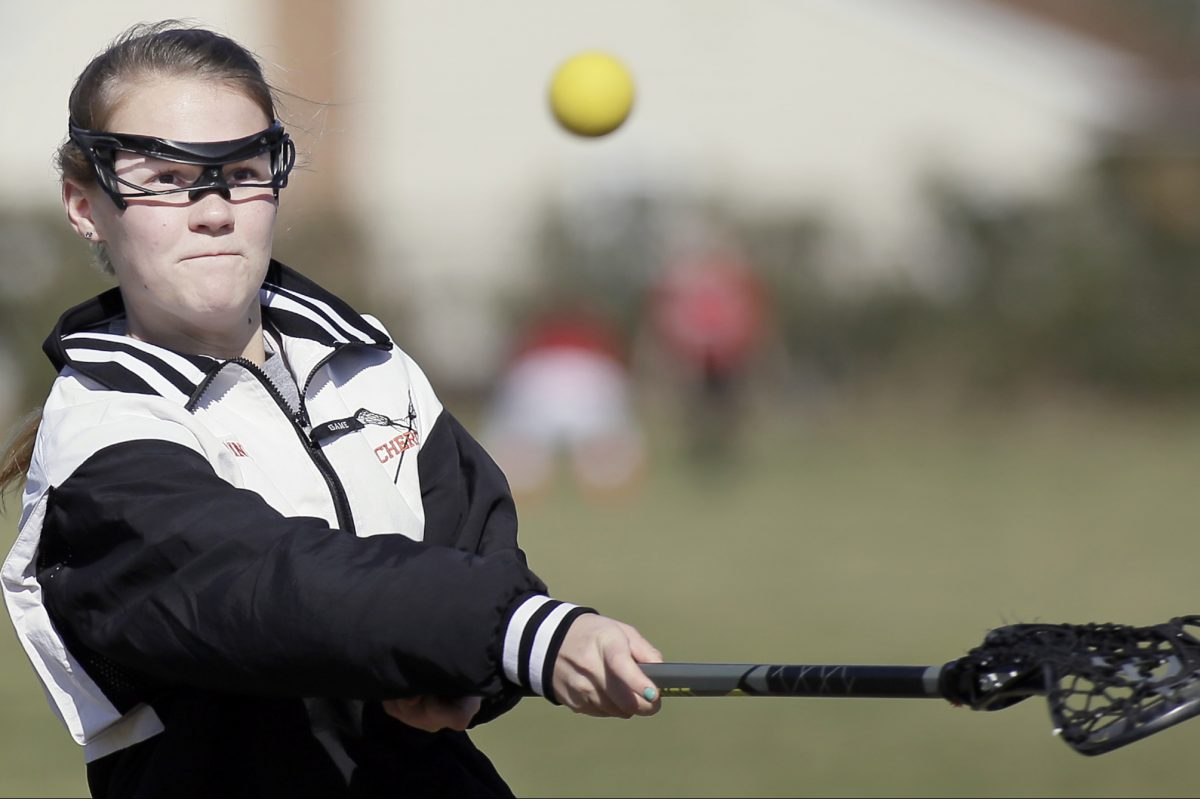 Cherokee H.S. girls lacrosse player Gab Bodine during a practice last season.