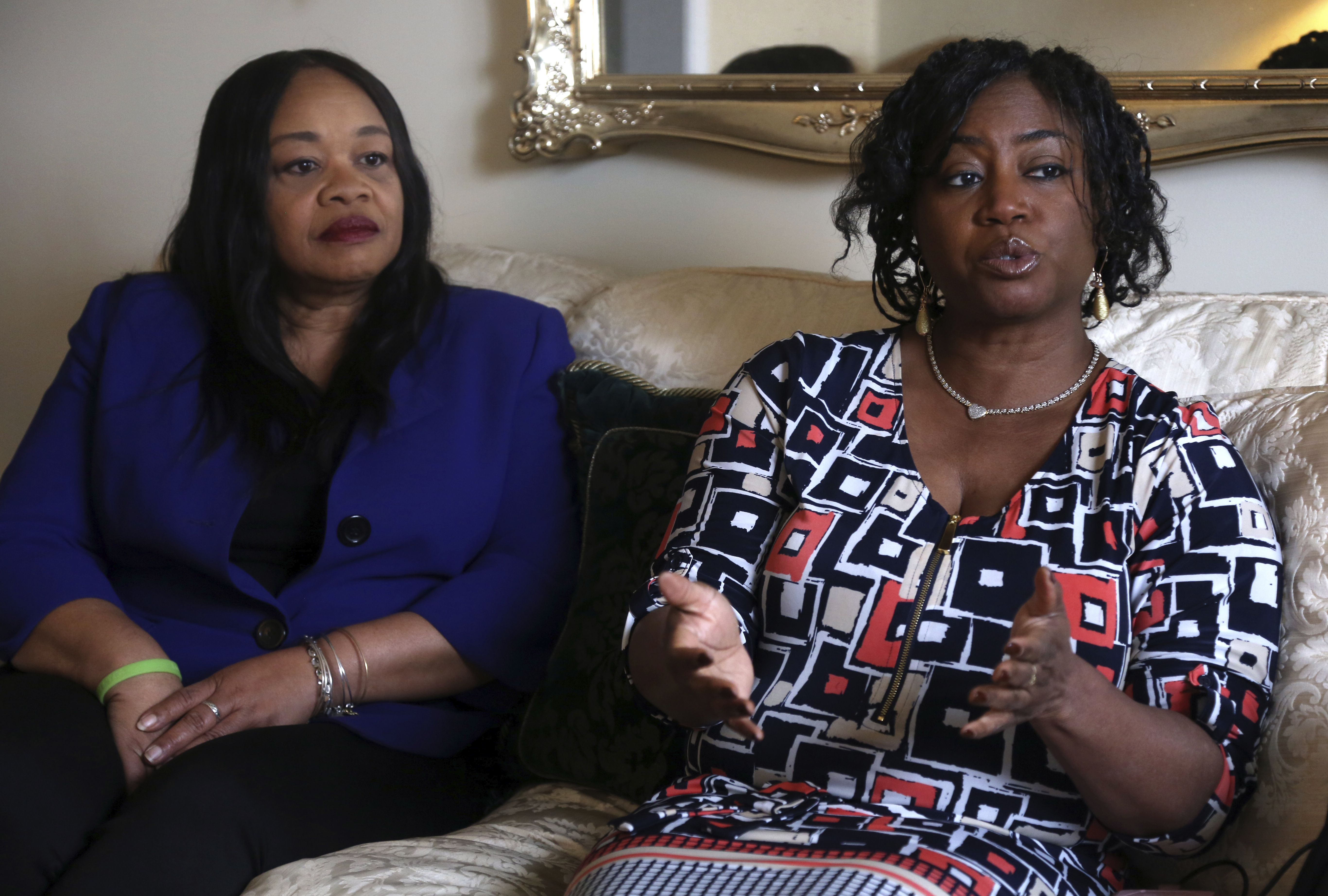 Sandra Thompson, right, speaks alongside Sandra Harrison, both golfers and members of a group of local women known as Sisters in the Fairway, during an interview with The Associated Press, Tuesday April 24, 2018 in York, Pa. Officials at the Grandview Golf Club in York called police on the group Saturday, accusing them of playing too slowly and holding up others behind them.