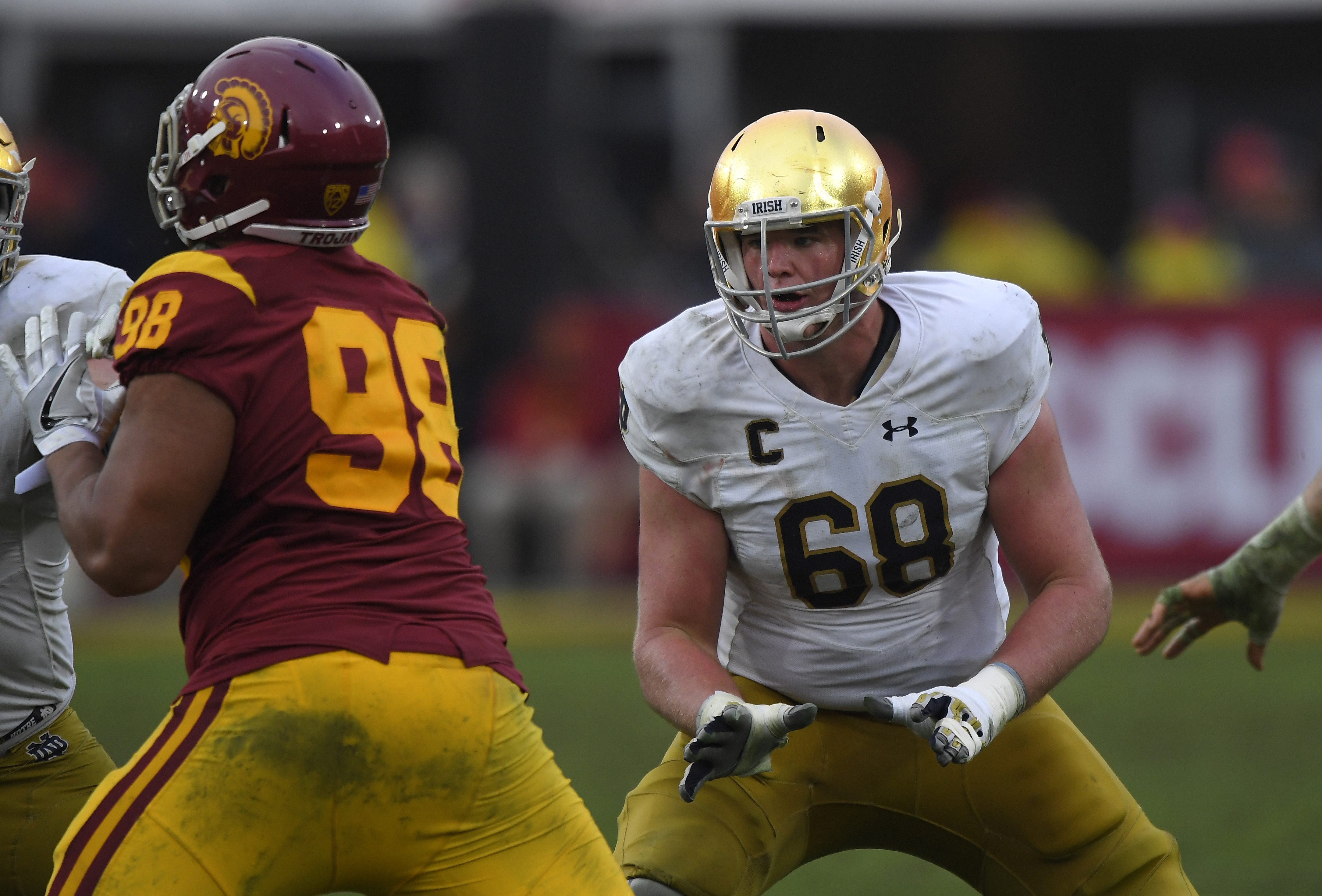 File-This Nov. 26, 2016, file photo shows Notre Dame offensive lineman Mike McGlinchey, left, blocking Southern California defensive tackle Josh Fatu during the second half of an NCAA college football game, in Los Angeles. McGlinchey was named to the second team AP Preseason All-America Team on Tuesday, Aug. 22, 2017. (AP Photo/Mark J. Terrill, File)