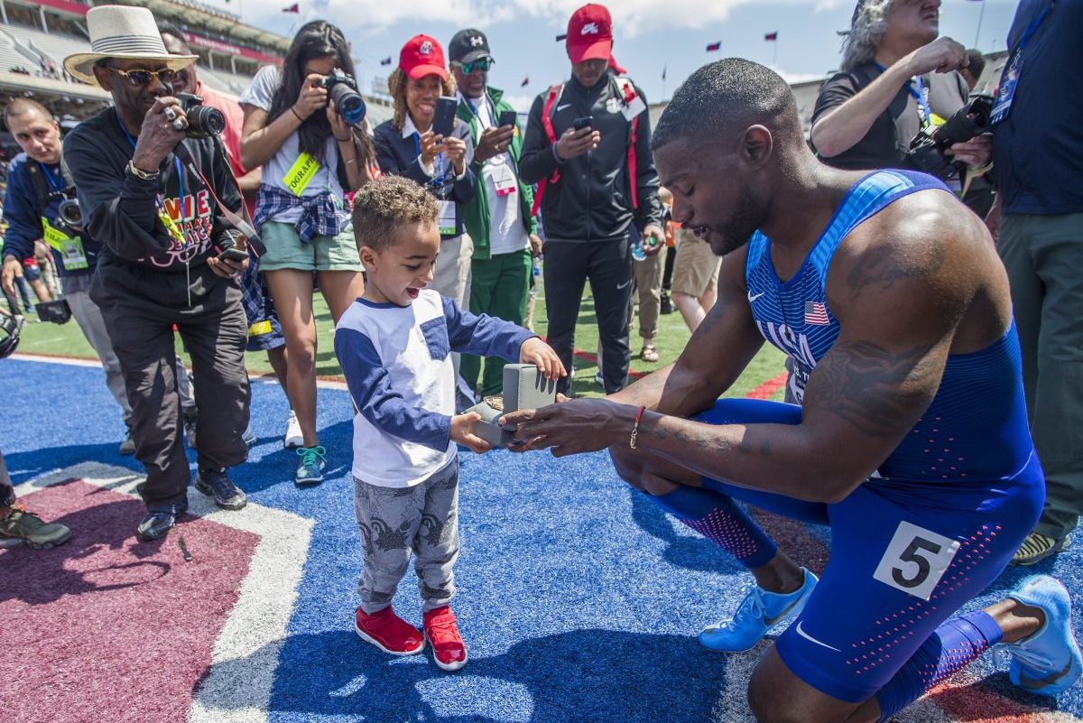 Justin Gatlin gives the watch he was awarded for winning USA vs. the World Men 4×100 to his nephew at the Penn Relays on April 28, 2018.