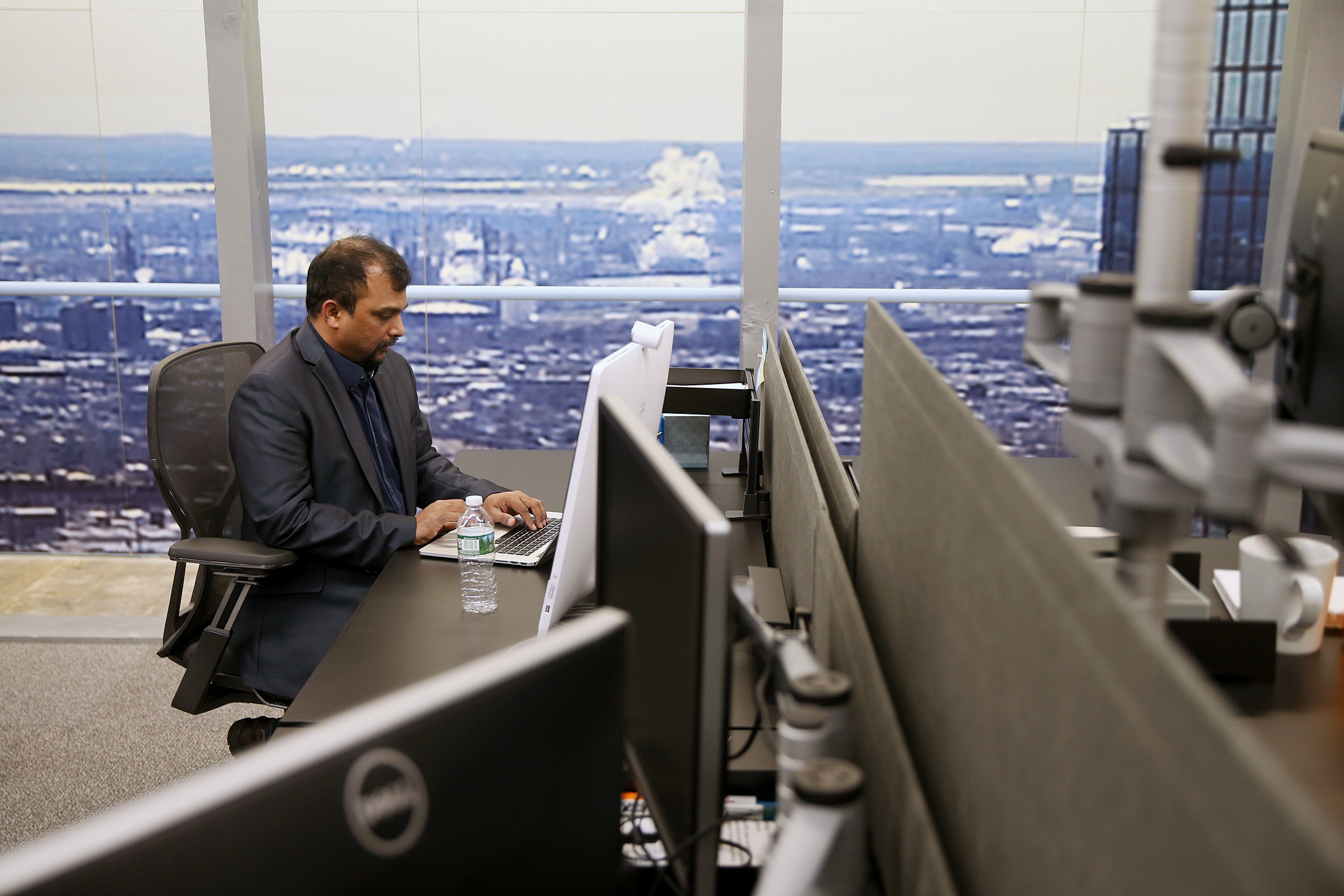 Antony Joseph, senior director of software development and engineering, works in December at Comcast´s mock-up in Horsha of its new skyscraper in Philadelphia. Again, what you´re seeing is not the city, but a picture of the city.