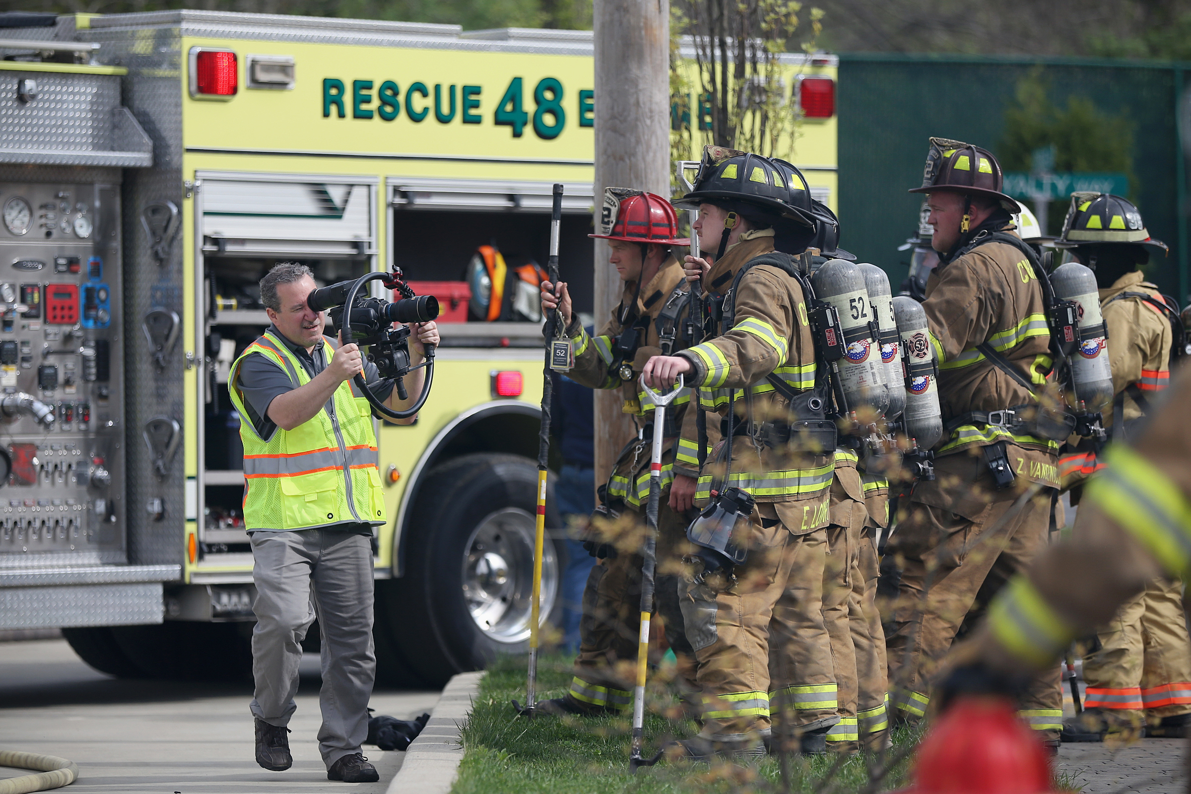 Aardvark Video Works owner Mike Fanaro films firefighters during a training exercise at the Chester County Public Safety Training Campus in Coatesville, Pa., on Saturday, May 5, 2018. Fanaro´s company was hired by Communication Solutions Group, a public relations firm working with the Chester County Fire Chiefs Association, to produce television and movie theater commercials to help recruit volunteer firefighters. TIM TAI / Staff Photographer