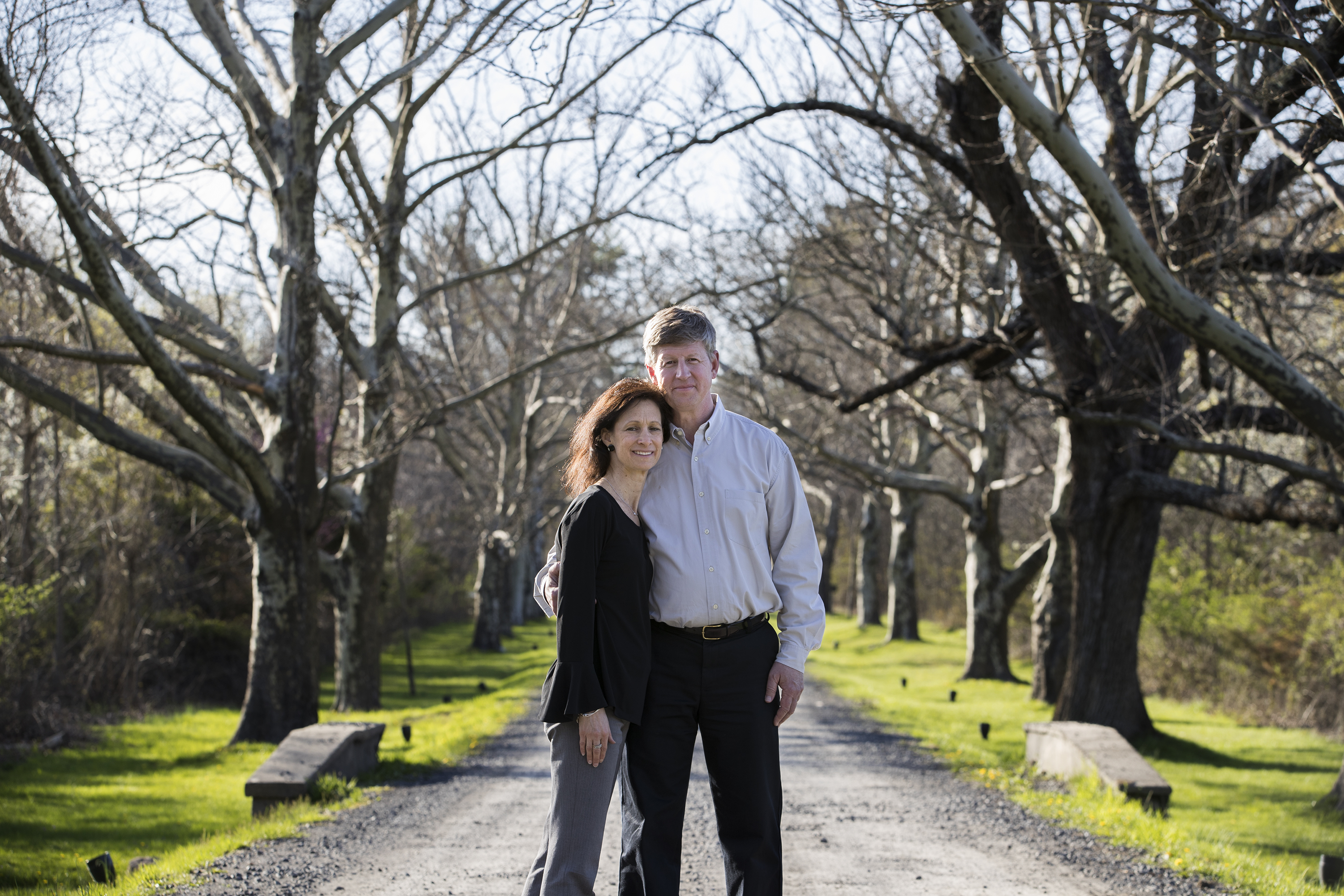 Owners Deena and Mark Frank along the tree-lined driveway at Barley Sheaf Farm.
