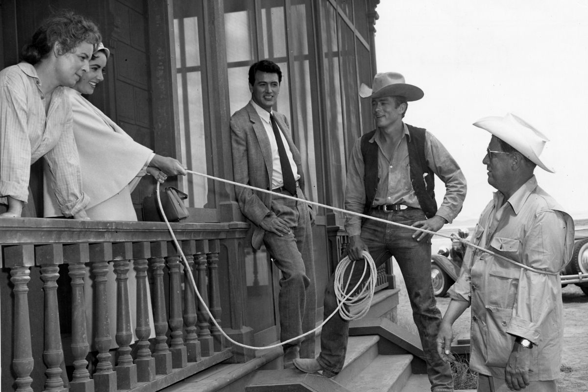 """On the set of """"Giant,"""" from left to right: Mercedes McCambridge, Elizabeth Taylor, Rock Hudson, James Dean, and director George Stevens."""