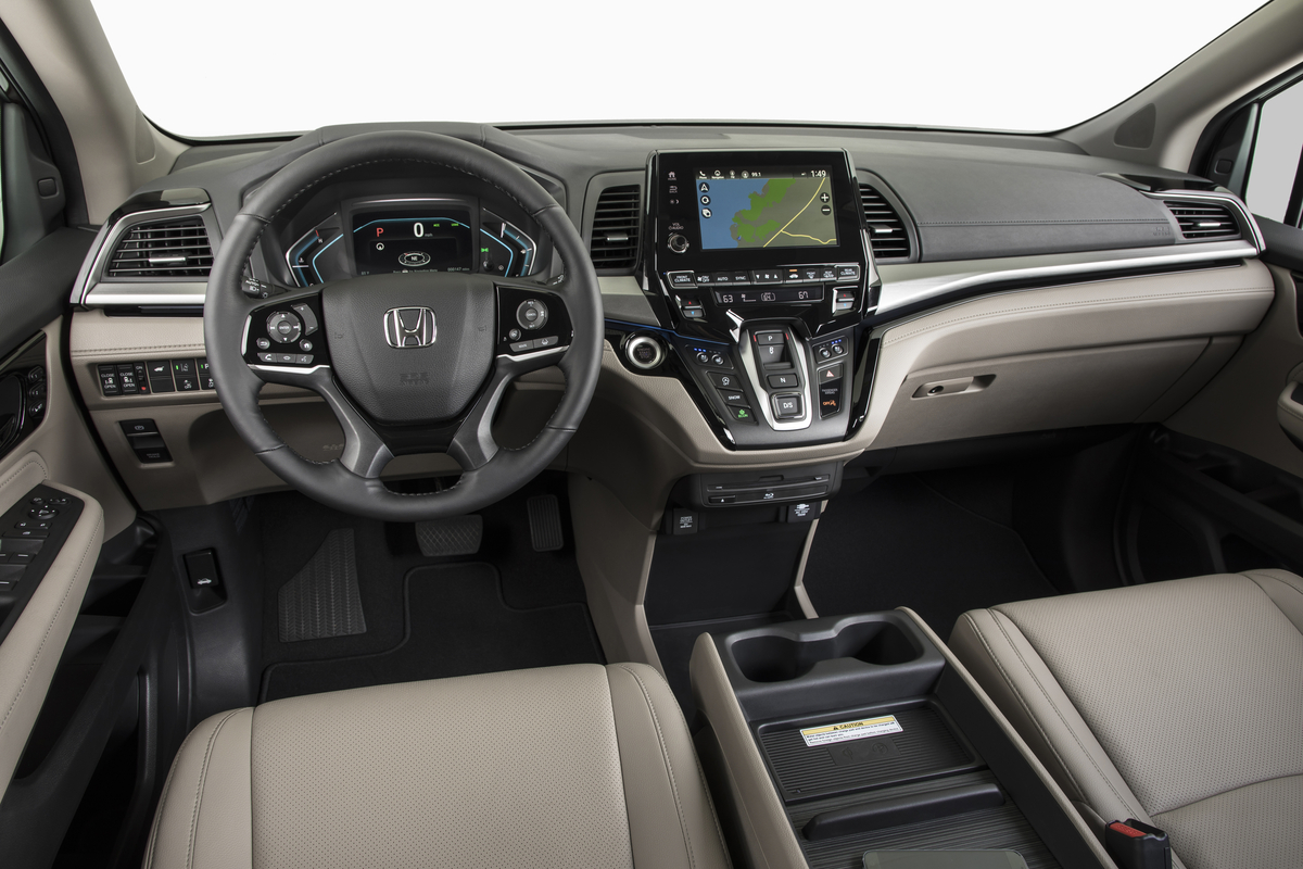 The interior of the 2018 Honda Odyssey is comfortable and pretty, although the stereo controls leave a bit to be desired.