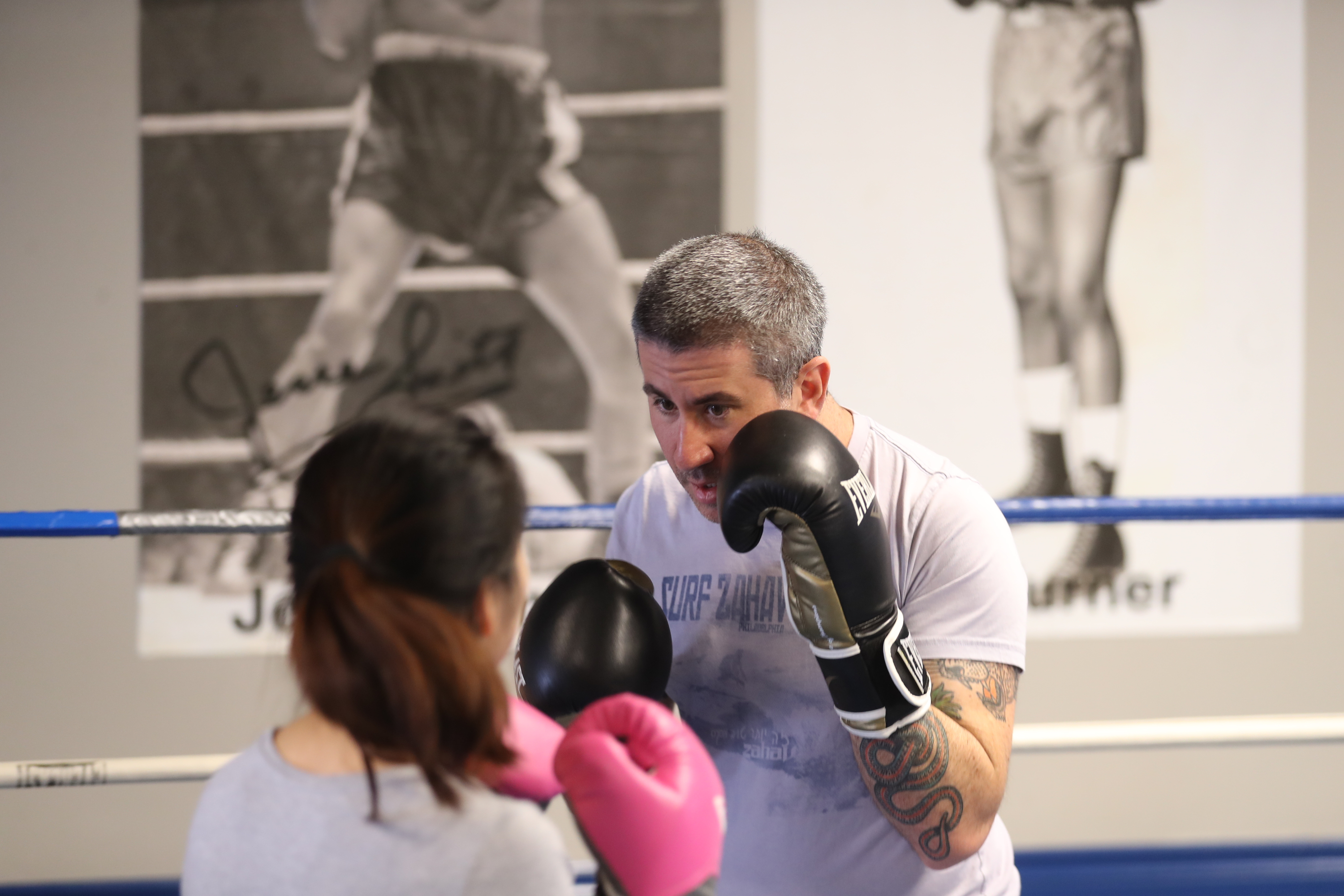 Inquirer reporter Bethany Ao spars with Michael Solomonov at Joe Hand Boxing Gym in Philadelphia April 30, 2018.