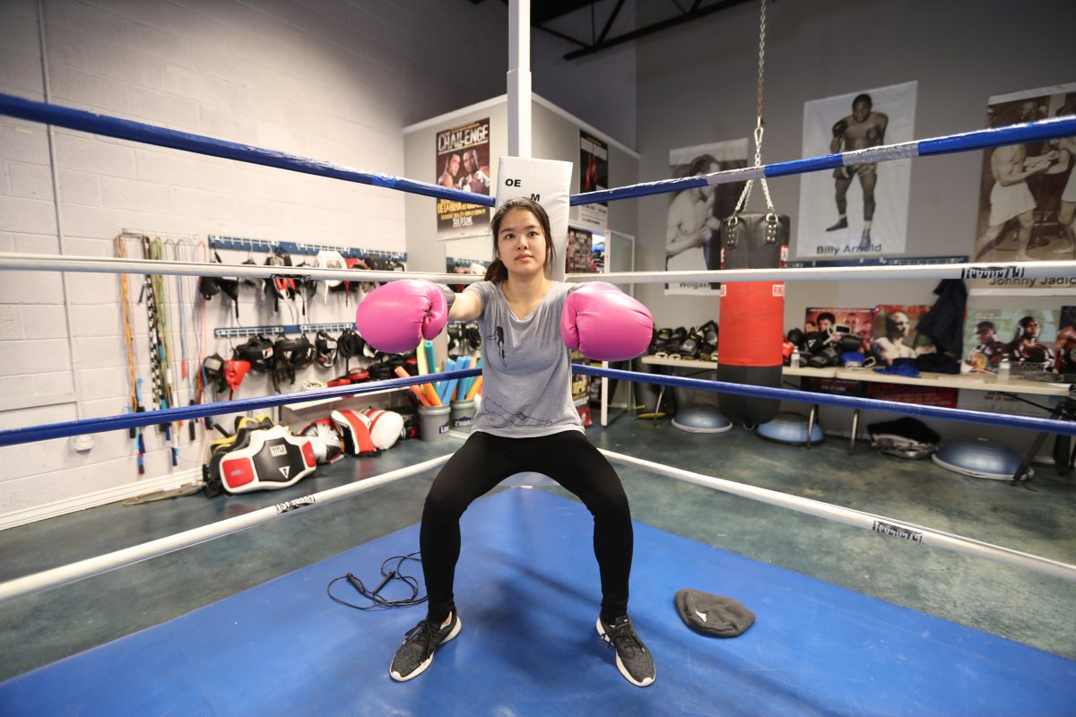 Inquirer reporter Bethany Ao gets a boxing lesson from Maleek Jackson at Joe Hand Boxing Gym in Philadelphia April 30, 2018.