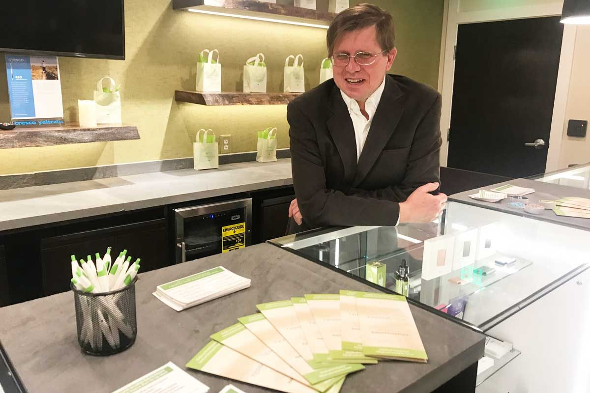 Val Gorski, CFO of TerraVida Holistic Centers, stands behind the counter in the customer consultation at the Abington dispensary on Old York Road.  The medical marijuana dispensary opened April 26.