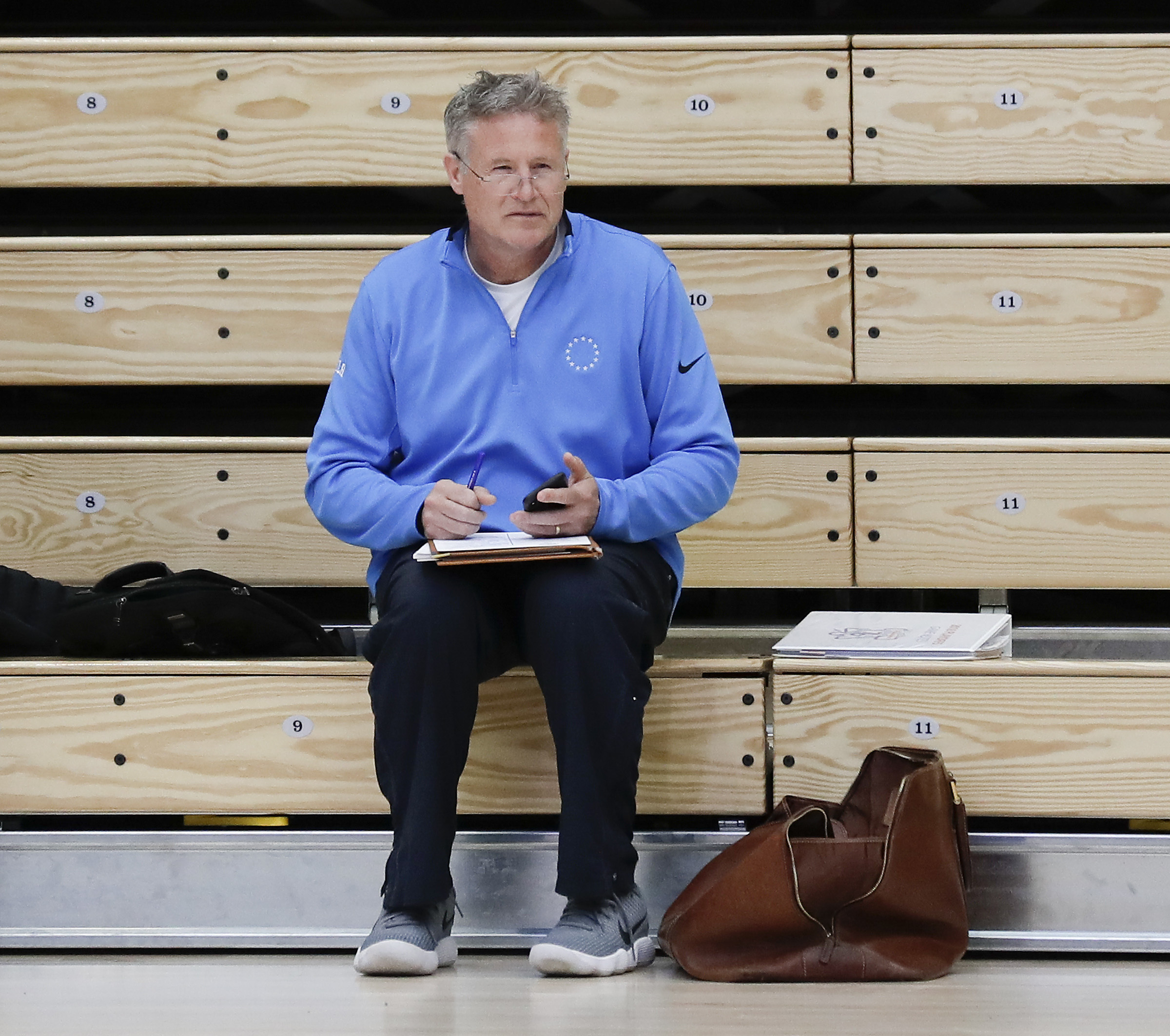Sixers Head Coach Brett Brown sits with his notes in Lavietes Pavilion at Harvard University before his team practiced on Tuesday, May 1, 2018. YONG KIM / Staff Photographer