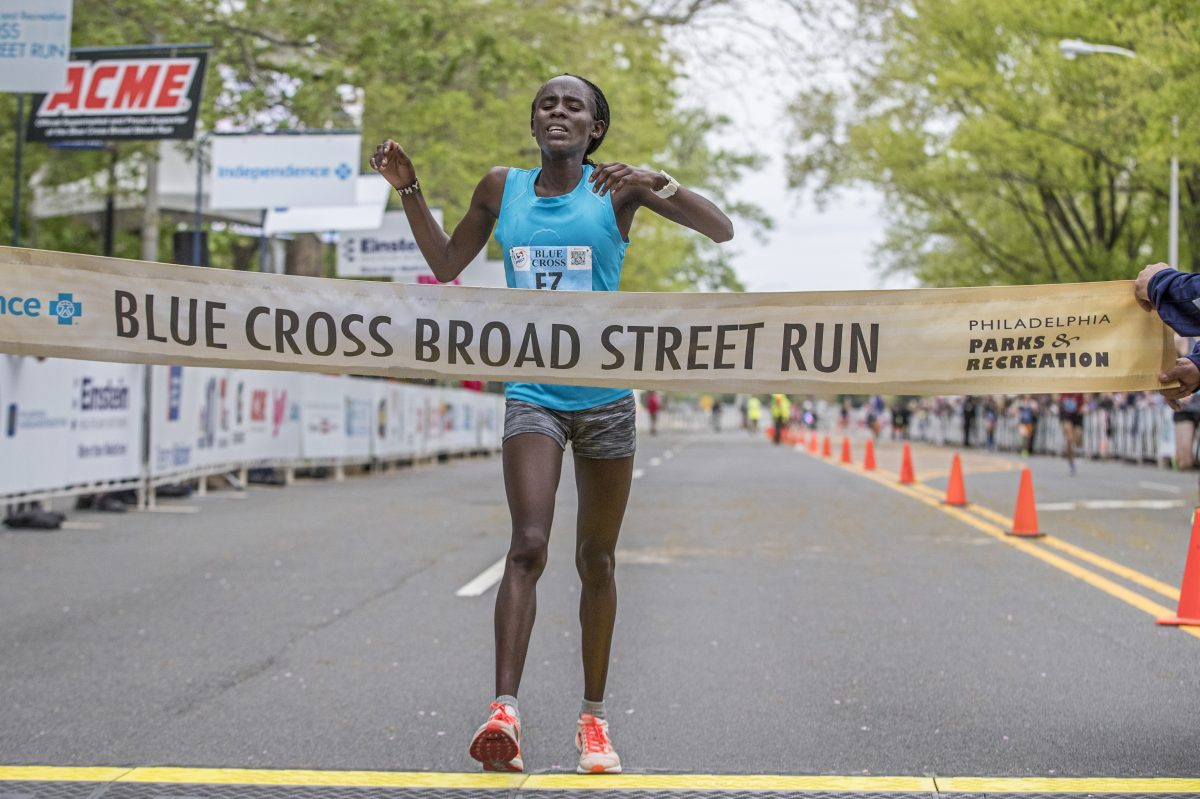 Sophy Jepchirchir crosses the finish line to win the women's division of the 2018 Blue Cross Broad Street run on Sunday May 6, 2018.