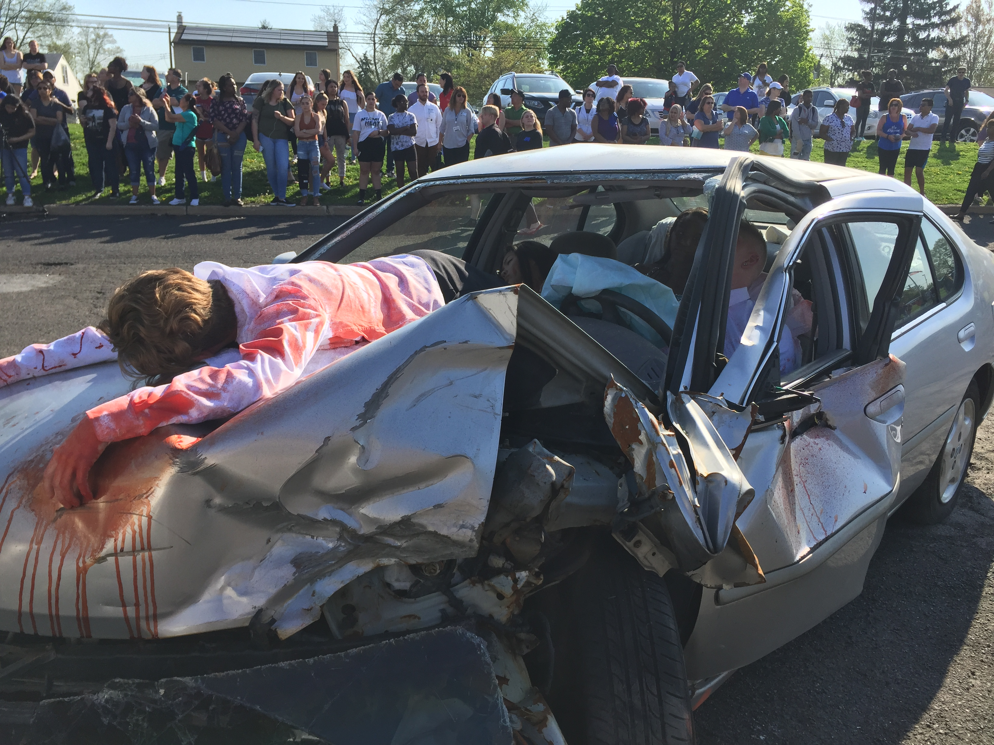 Chazen Murray plays a passenger who was ejected from the back seat onto the hood of the car during a mock crash at Truman High School.KATHY BOCCELLA