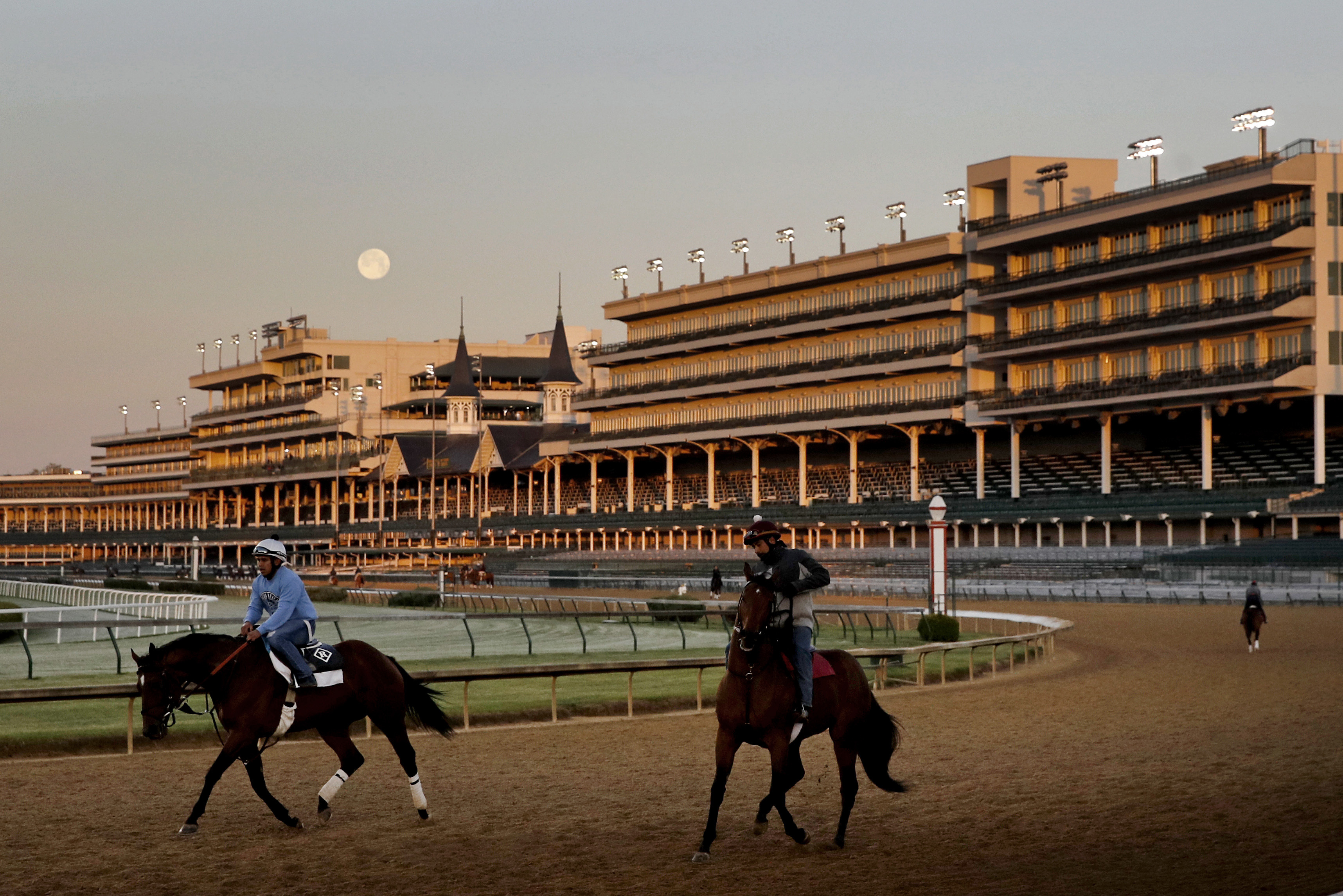 The full moon sets beyond the grandstands on a recent evening at Churchill Downs in Louisville, Kentucky.