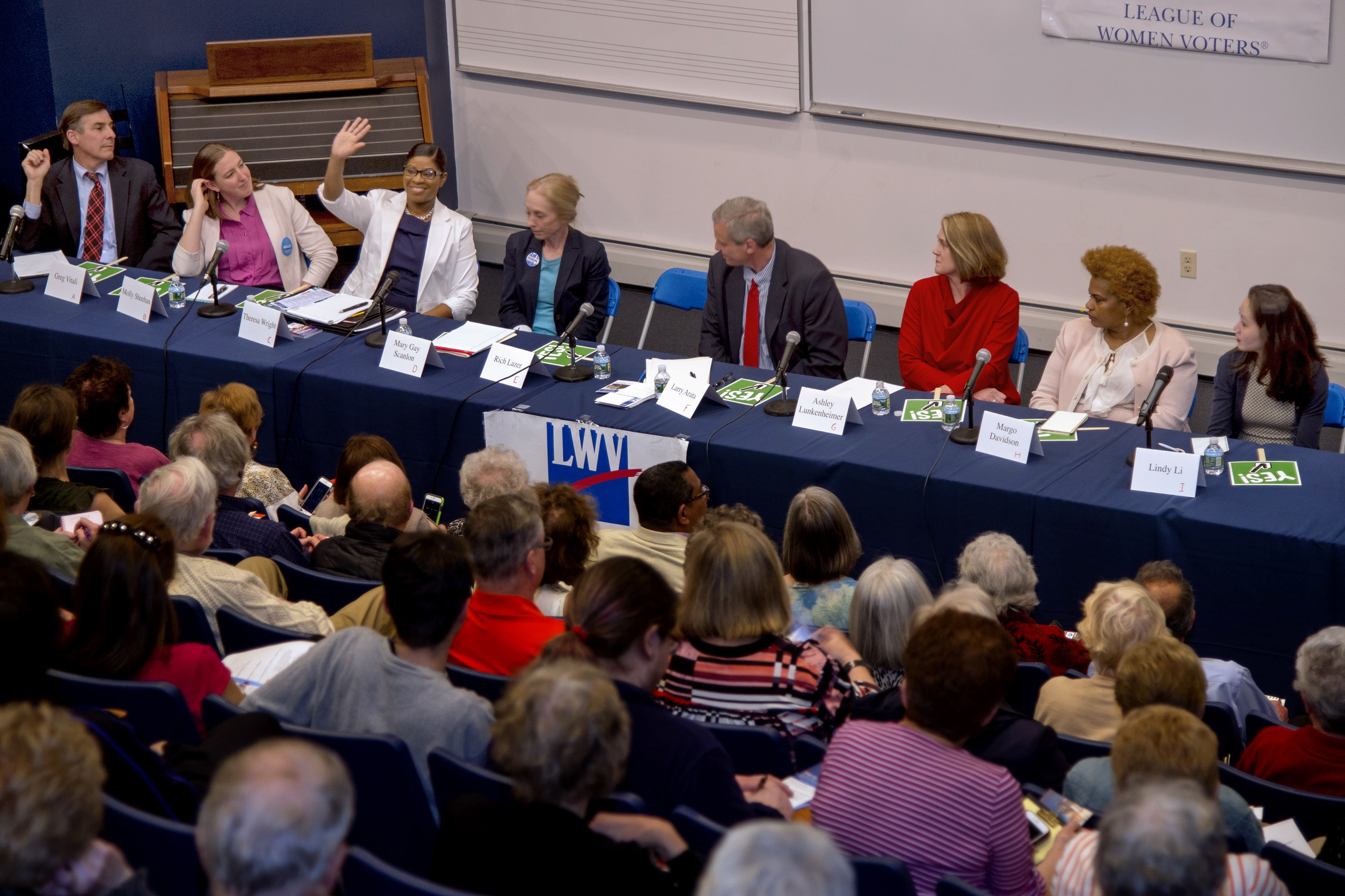 A record number of candidates filed to run for U.S. House in Pennsylvania. Here at a May 1 debate are Democratic Fifth District primary rivals (from left) Greg Vitali, Molly Sheehan, Theresa Wright (waving), Mary Gay Scanlon, Larry Arata, Ashley Lukenheimer, Margo Davidson, and Lindy Li.