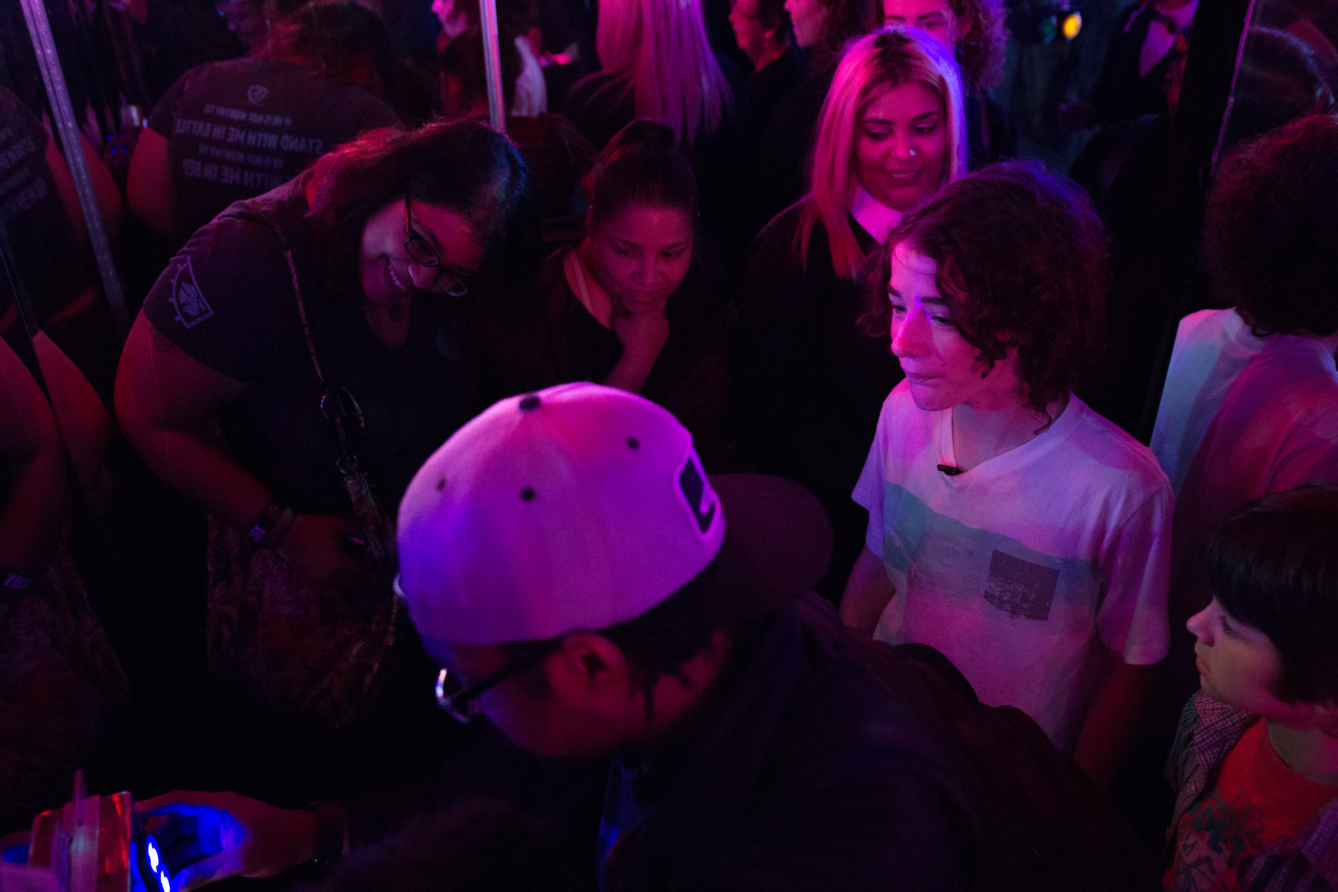 Visitors try to navigate the Intergalactic Escape, escape room at the Franklin Institute.
