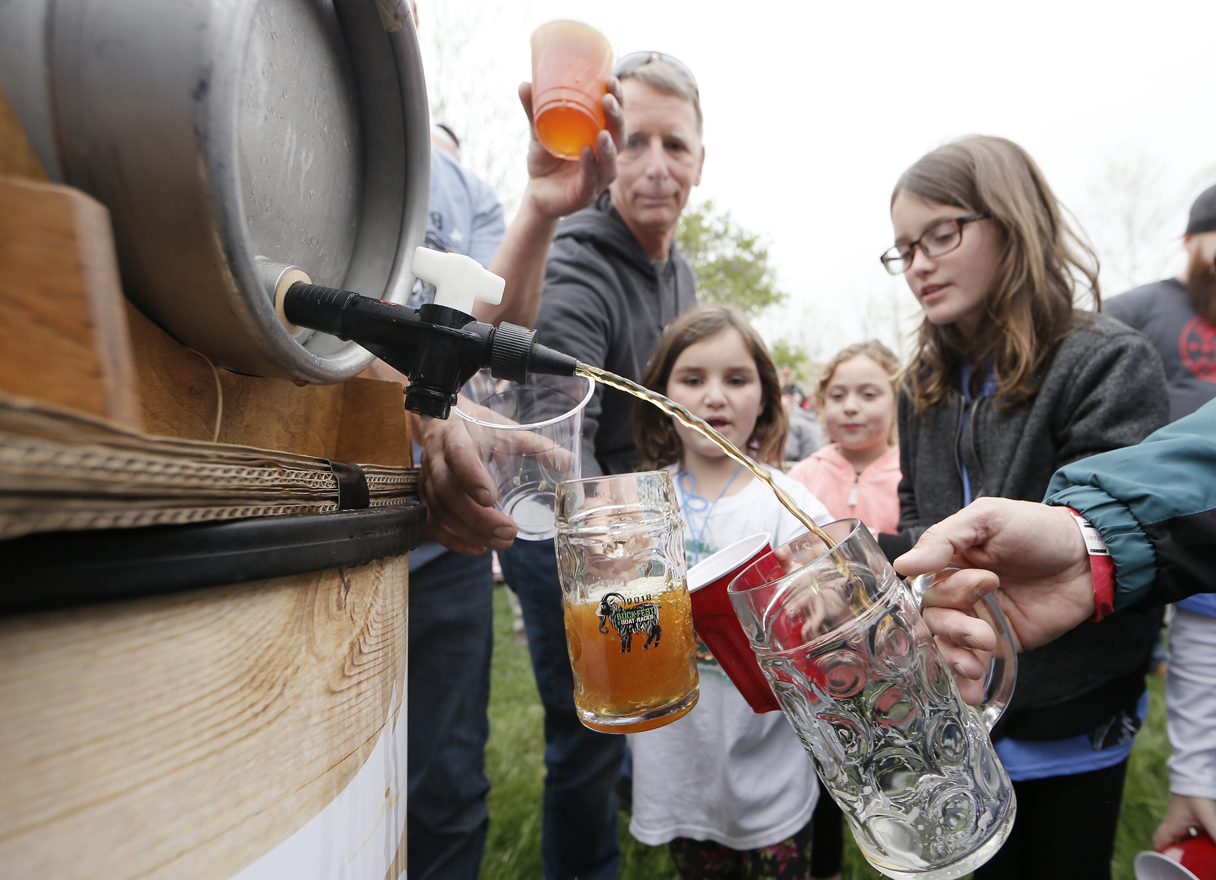 People of all ages line up to get some newly tapped Princess Jenny Maibock beer immediately after the final goat race during the annual Sly Fox Bock Fest and Goat Race held at the Sly Fox Brewery and tasting room in Pottstown, Pa. on May 6, 2018.