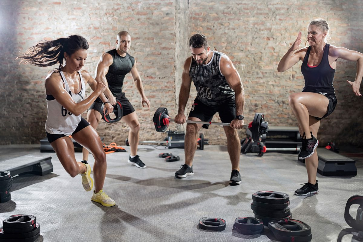 Gym-goers perform HIIT exercises.