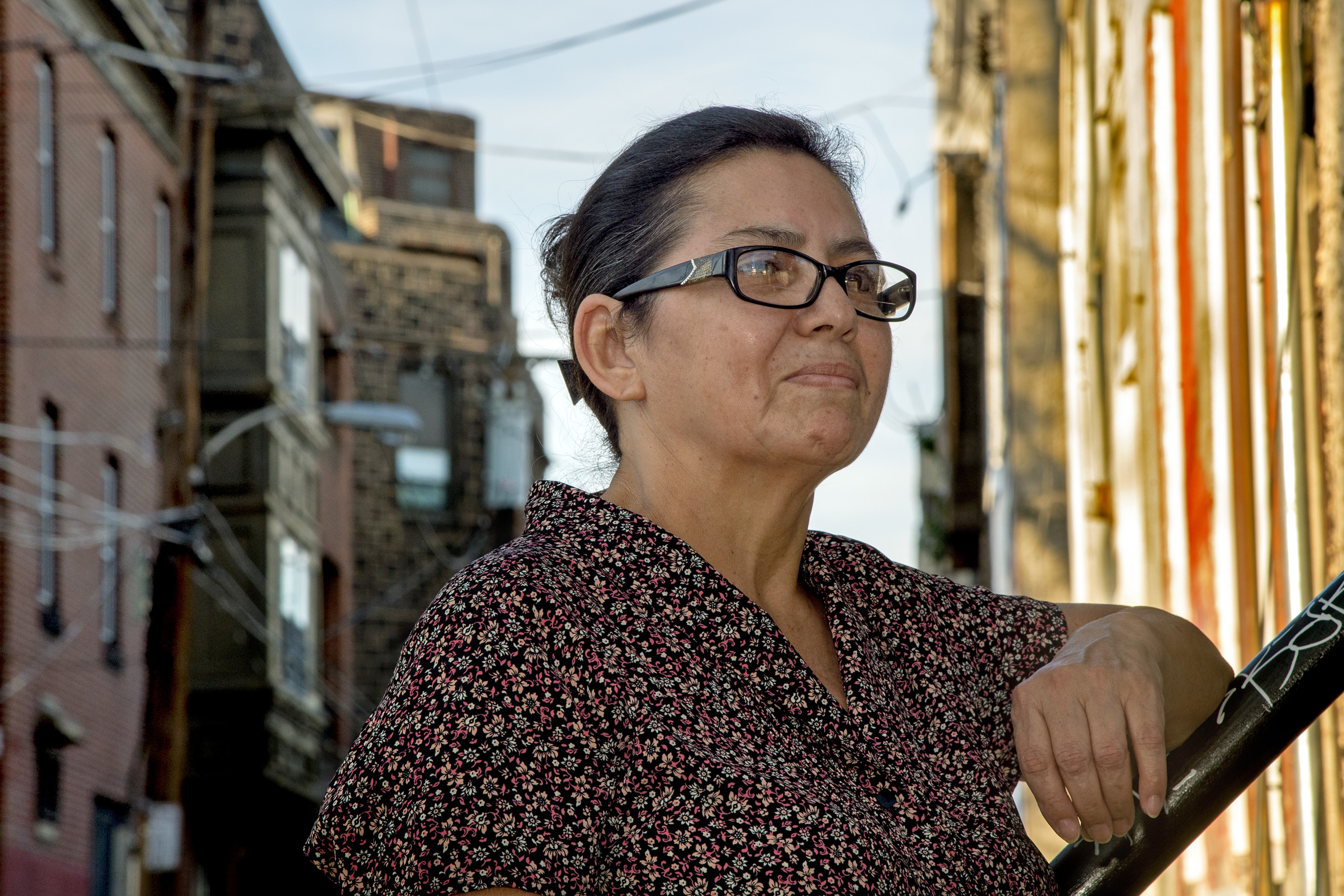 Miriam Turcios, originally from Honduras, pauses outside the Kensington offices of New Sanctuary Movement of Philadelphia. The Trump administration revoked the Temporary Protected Status that allows Turcios and others to live and work here legally.