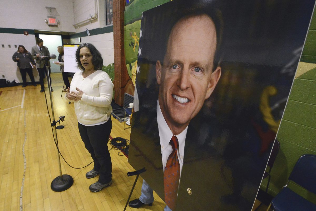 Anna Washick of Thornhurst, Pa., tells her story regarding health care next to a large photograph of Pennsylvania U.S. Senator Pat Toomey (R), who was invited to speak, but did not attend the meeting on Tuesday, Feb. 21, 2017, held at the United Neighborhood Center in Scranton, Pa. ( Butch Comegys / The Times & Tribune via AP) MANDATORY CREDIT