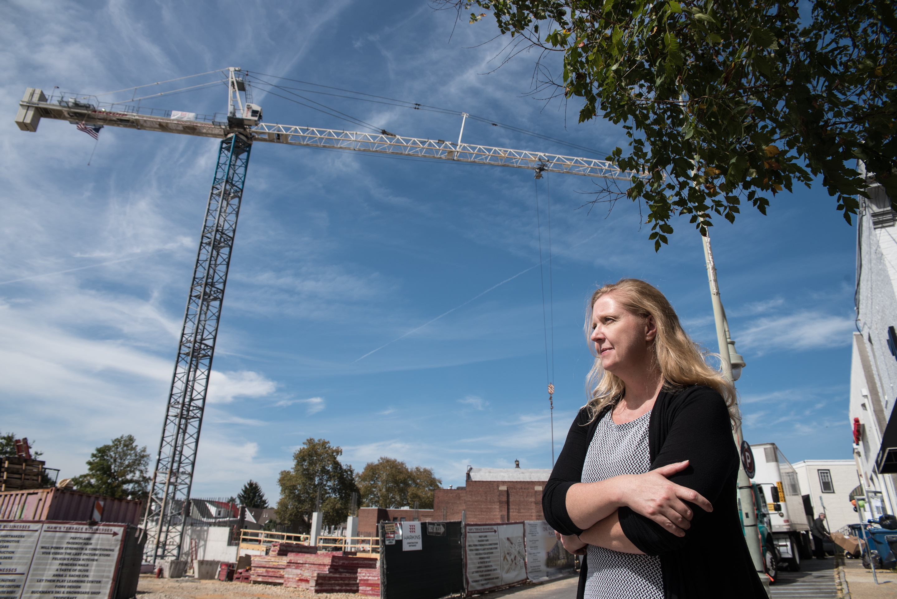 Carrie Kohs surveys the construction site for a controversial mixed-usage building just off Lancaster Avenue in Ardmore. As a local business owner and activist in the business community, she is in favor of the development other local business owners and residents have opposed. Friday, September 22, 2017, Ardmore, Pennsylvania.
