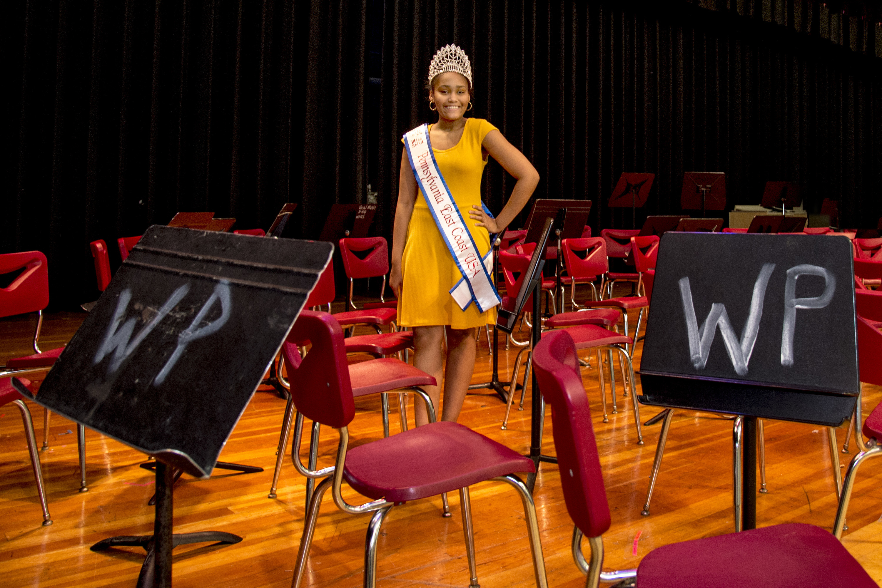 Aliyana McCrary, 13, poses with her East Coast USA Pageant crown and sash at her William Penn Middle School in Yardley May 1, 2018.