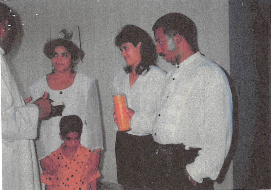 From left: Rev. Dionisio Suarez Arias baptizes Juan Alexander Reynoso, age 5, in front of his mother, Catalina Roman, godmother Eunice de la Rosa Cabrera and father Pedro Reynoso on July 27, 1991. The photo was submitted in support of Reynosos alibi.
