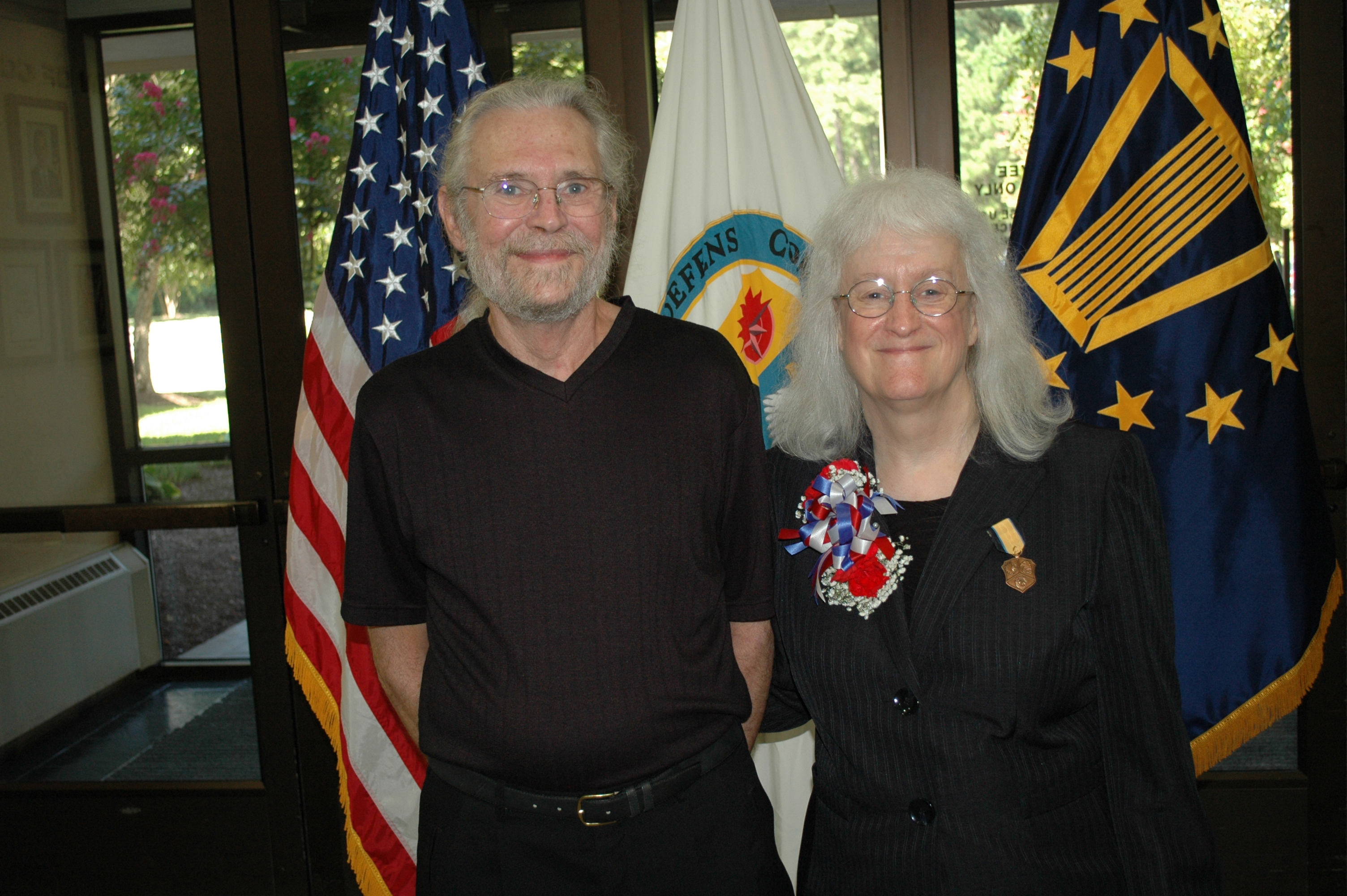 Louis and Kristen Ogden live in Virginia. He takes high doses of opioids to treat his chronic pain. This photo was taken at her retirement ceremony in 2014.