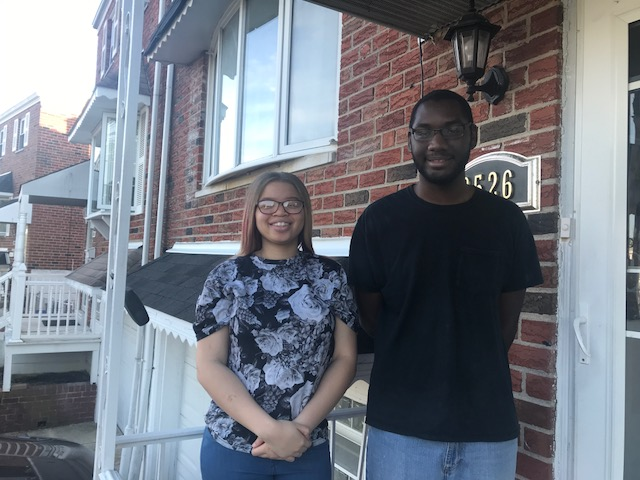 Ciahnnie Barley, 16, and Dante Washington, 20, on the porch of their Northeast Philadelphia home.