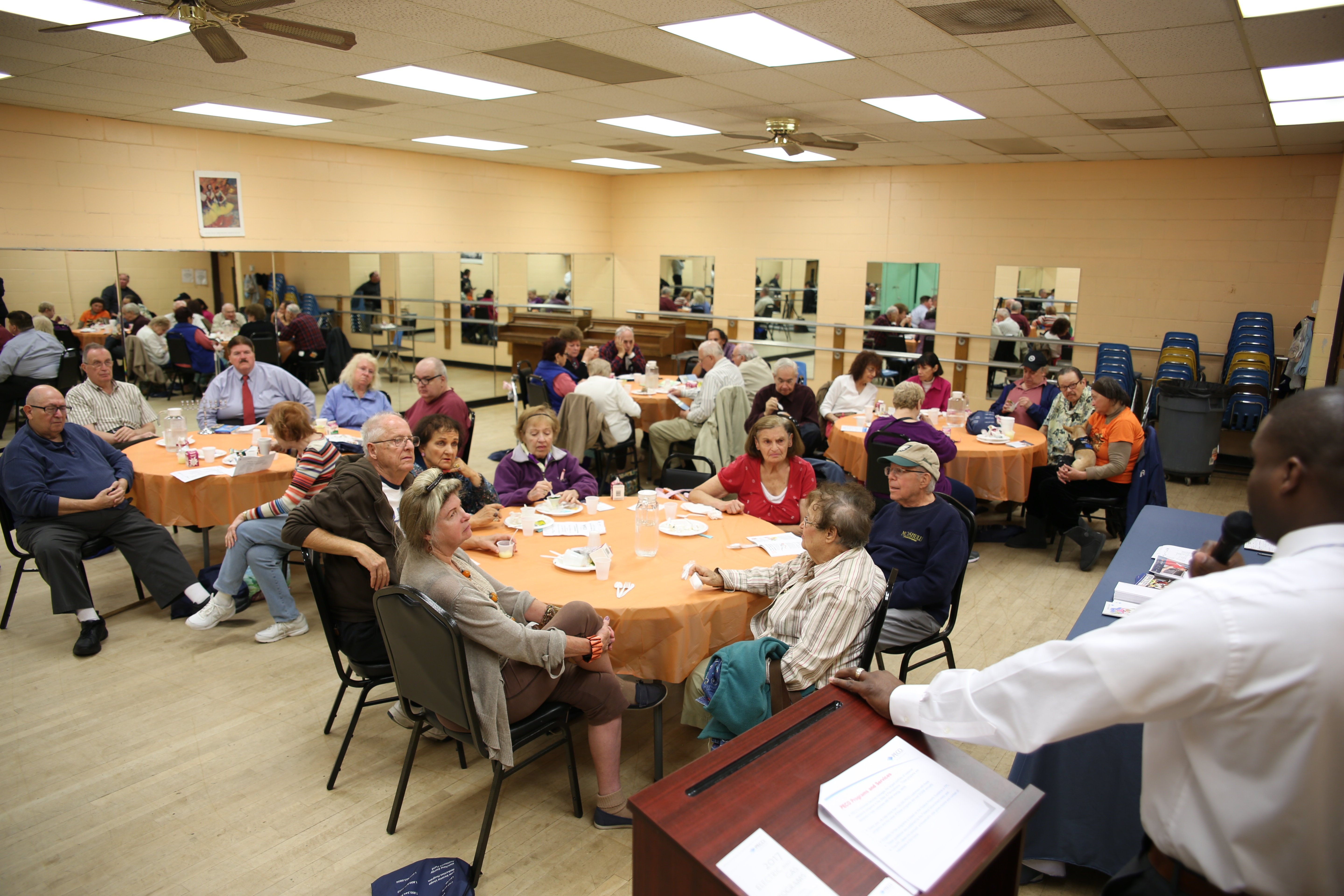 Seniors socialize at the Rhawnhurst NORC, operated by the Jewish Federation in partnership with Catholic Health Care Services, helps older adults living within Philly ZIP codes of 19111, 19114, 19115, 19116, 19149 and 19152. The NORC--naturally occuring retirement community--provides maintenance and repairs; transportation to medical appointments and grocery shopping; lunch and learn gatherings; and friendly visits. (Credit: JewishPhilly.org)