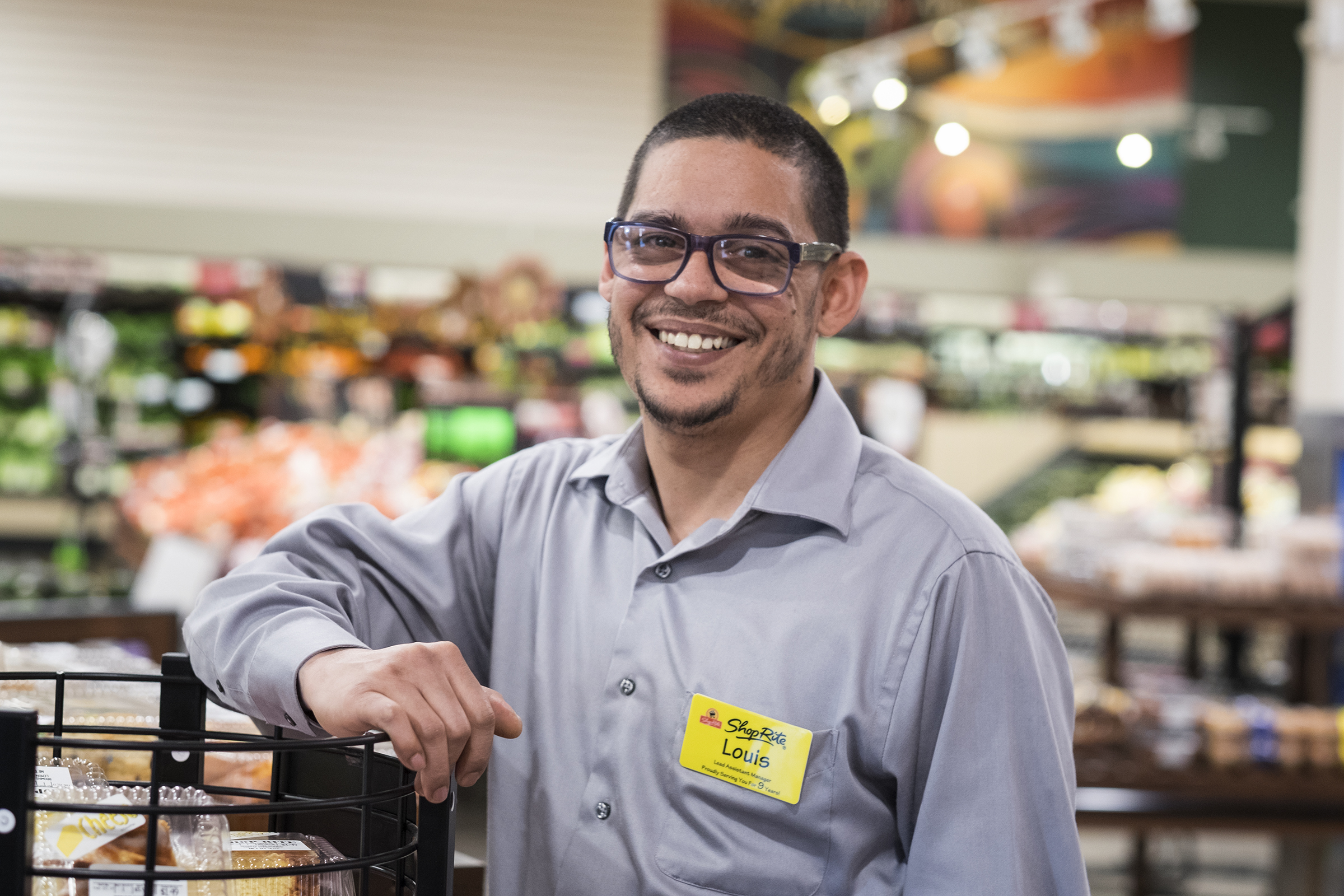 Louis Rivera, 40, a former drug dealer who has served time and has been employed by ShopRite for nine years, was promoted to lead assistant manager at the East Norriton Square store. ED HILLE / Staff Photographer.