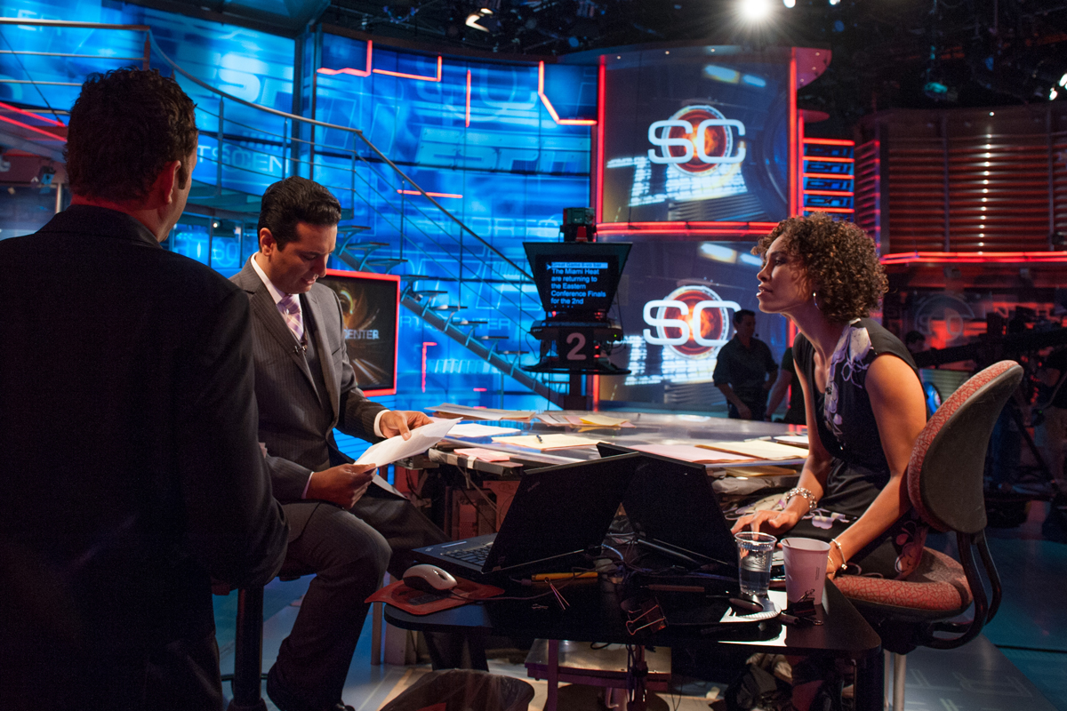 Kevin Negandhi on the SportsCenter set with Sage Steele during an interview with Vince Vaughn in 2012.