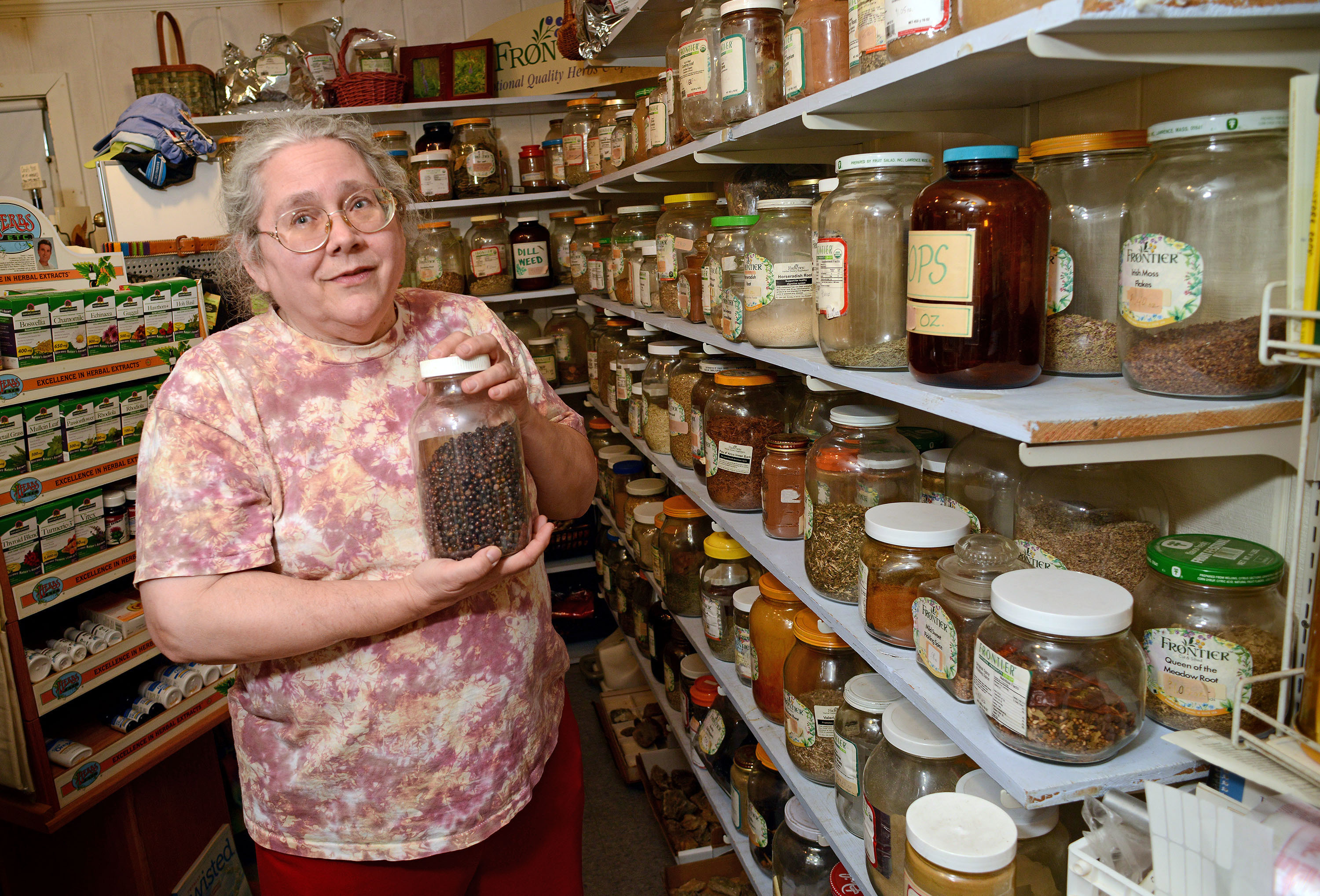 Karen Stauffer, shows some of the herbal items she sells at her River of Life Natural Foods store in Lahaska, Pa. W