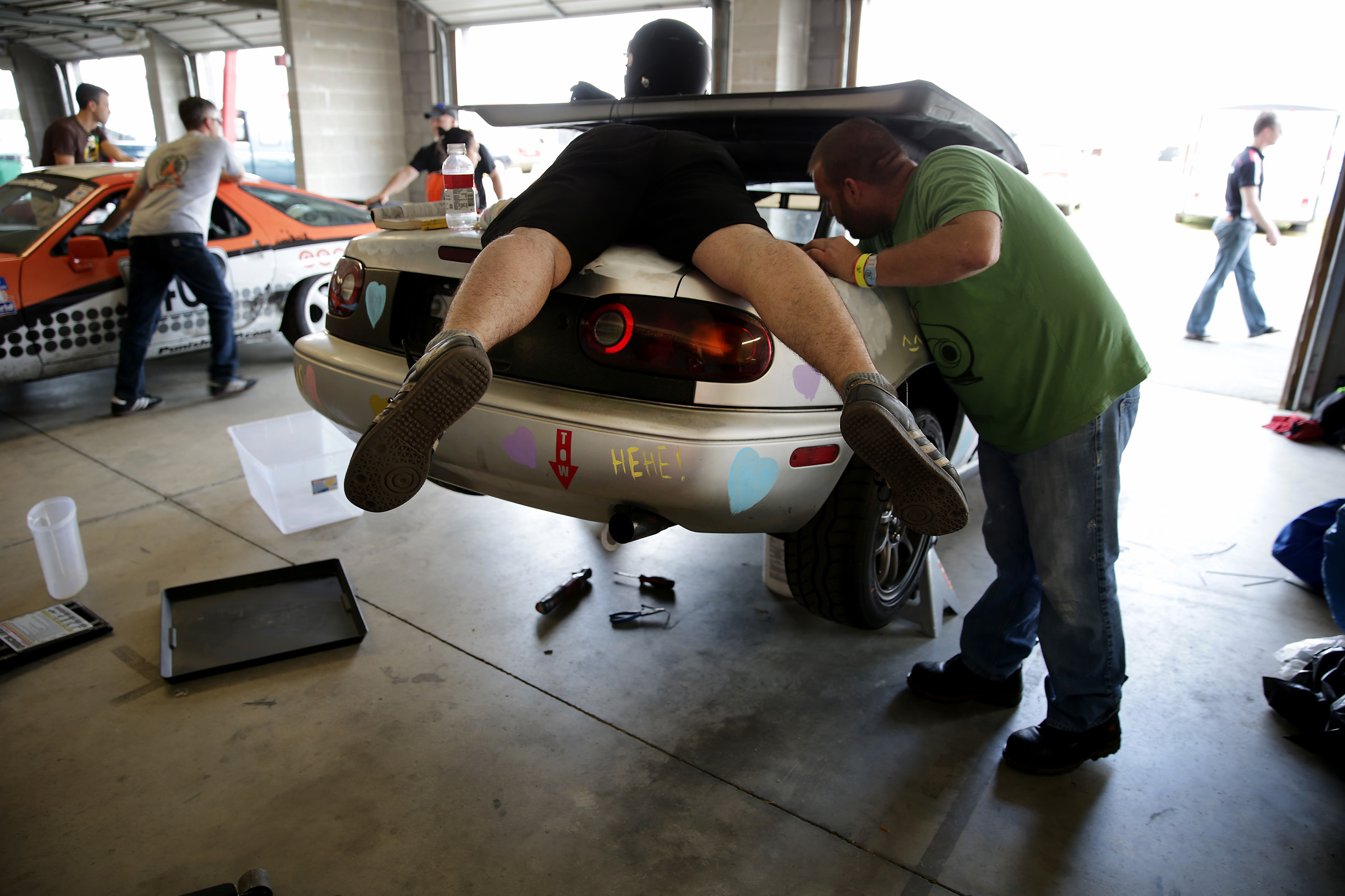 Bill Schonman, left, of Fleminington, NJ, and Mike Hartigan, of Westampton Township, NJ work on their car during the 24 Hours of Lemons: The Real Hoopties of New Jersey test and tech day at New Jersey Motorsports Park in Millville, NJ on May 11, 2018. DAVID MAIALETTI / Staff Photographer