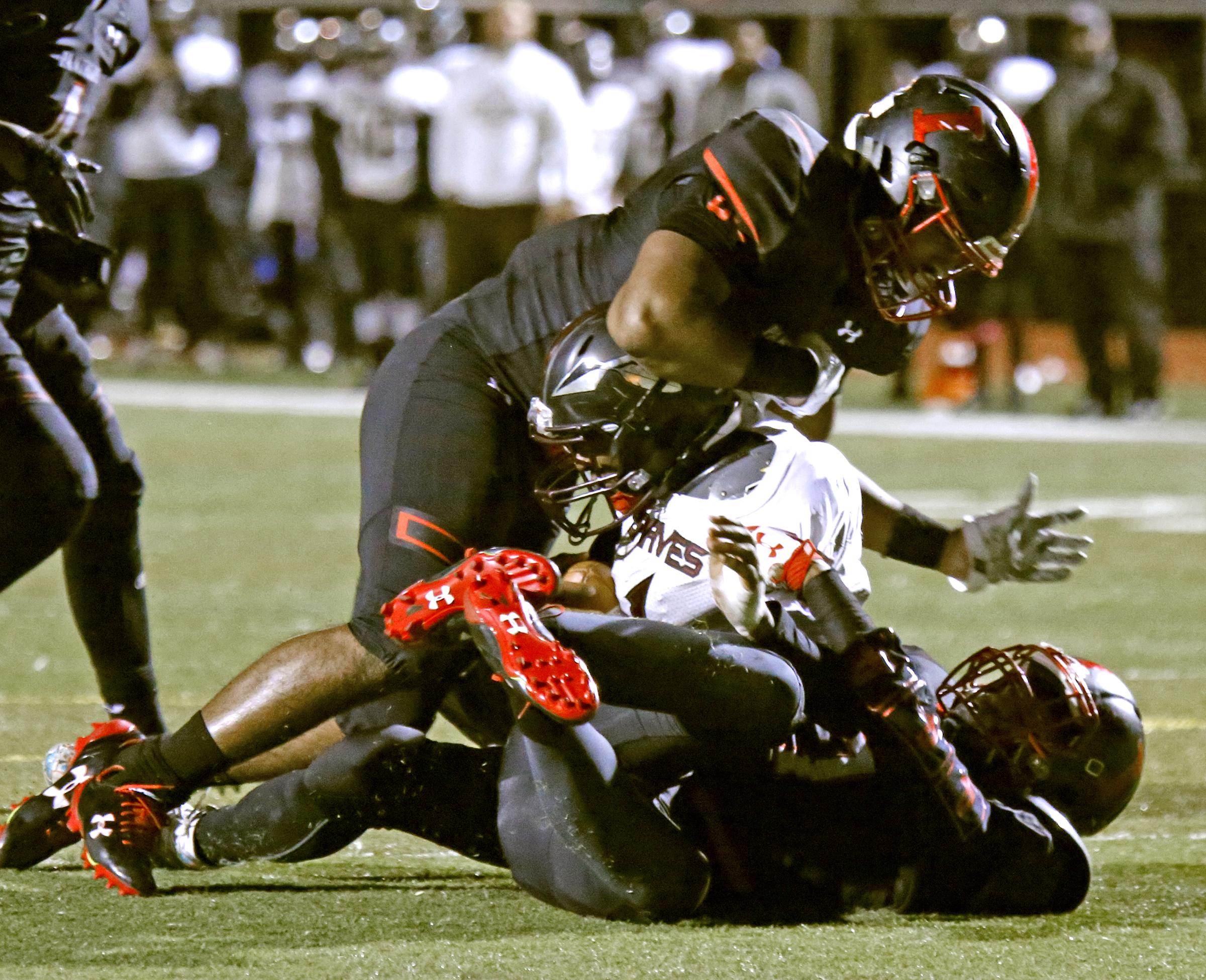 Omar Speights (top) and Kamal Harrison sack Bartram quarterback Mahmud Dioubate in Imhotep Charters 33-0 win last season.