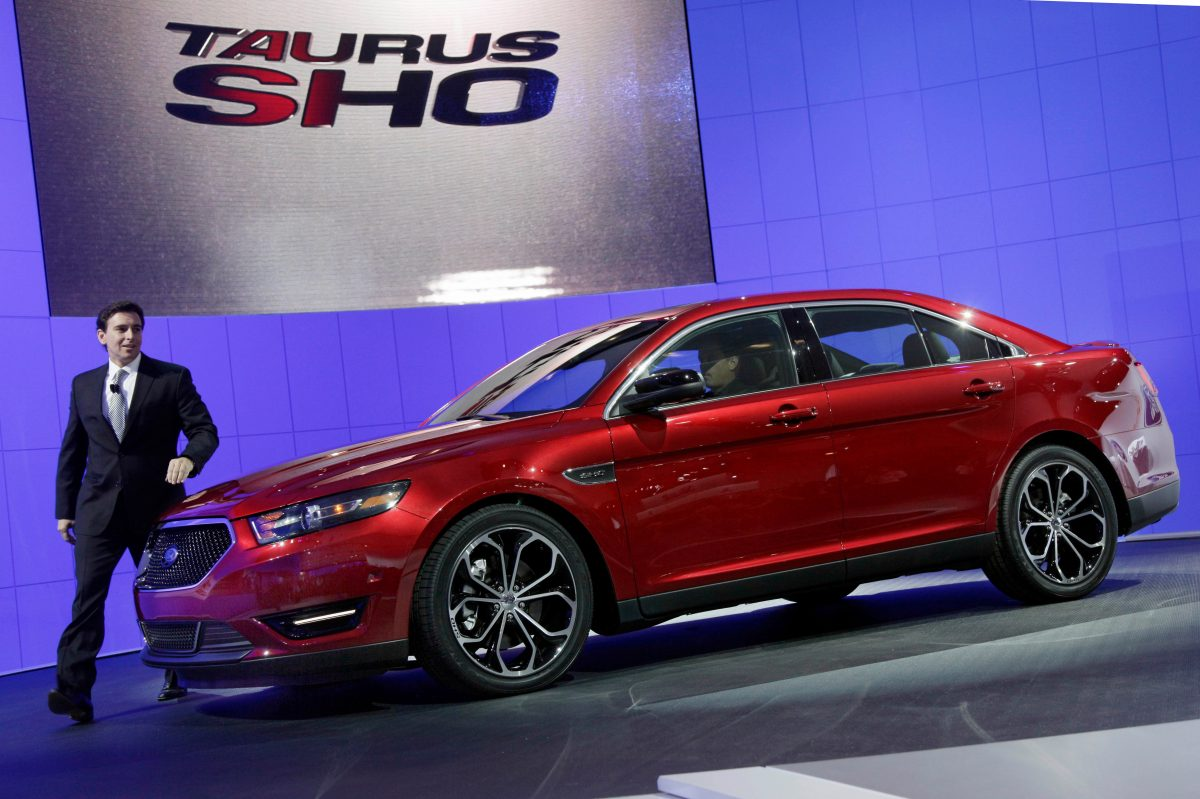 Mark Fields, executive vice president, Ford Motor Company, introduces the 2013 Ford Taurus SHO at the New York International Auto Show. In about a year, a car that once was the most popular in America will die again as Ford shifts its focus to SUVs and trucks.
